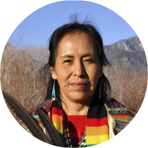 Pat McCabe, known as Woman Stands Shining, is a Diné (Navajo) mother, grandmother, activist, artist, writer, ceremonial leader and international speaker.