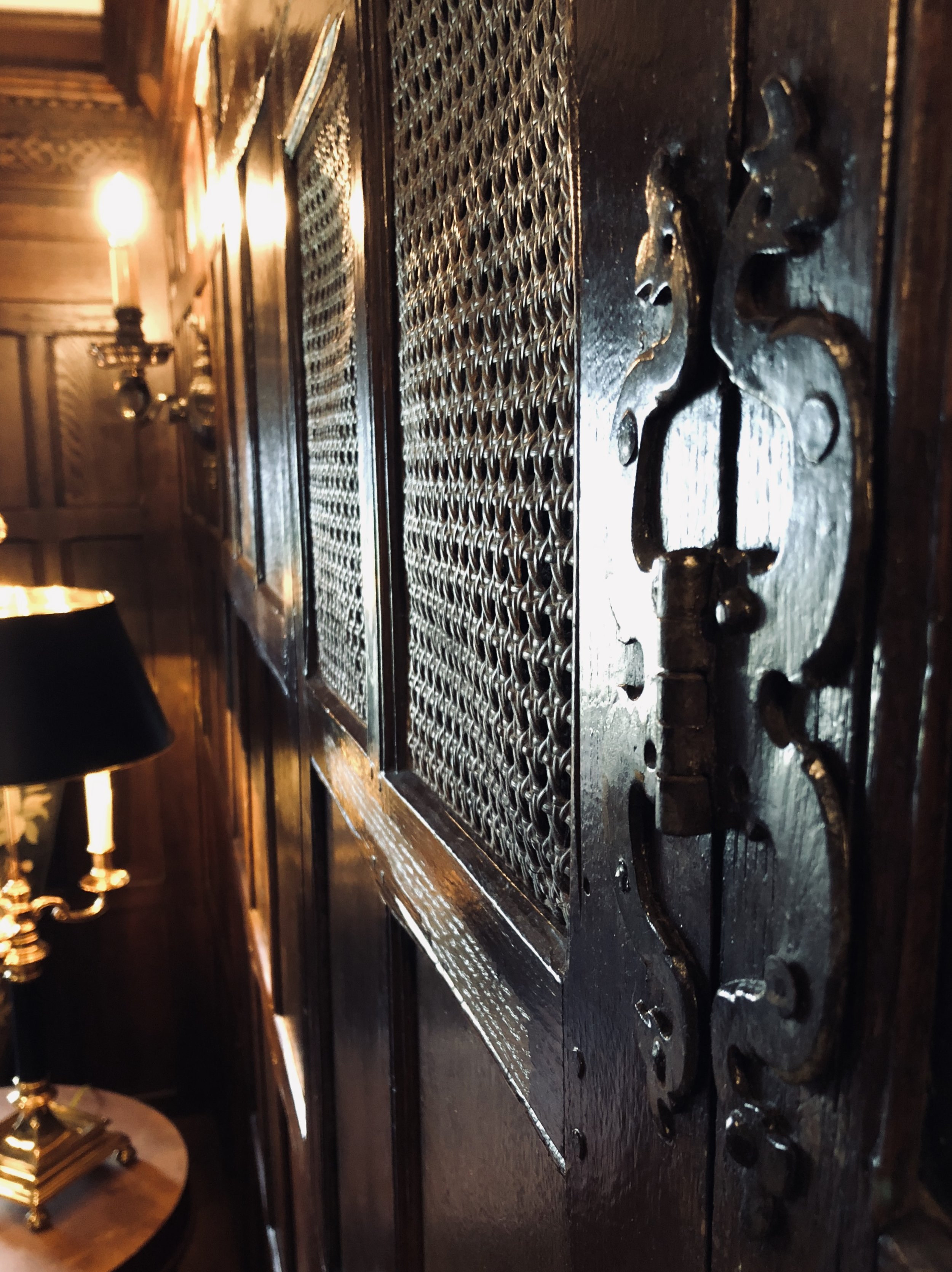 This secret door once led to a tunnel used for bootlegging liquor; the door was originally hidden by a tapestry