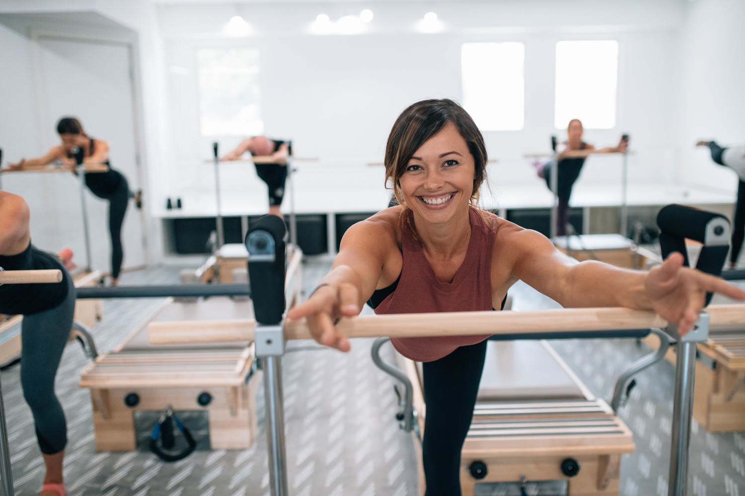 We are a Pilates studio unlike any other. - Our passionate team, custom-designed machines, and 5 kick-ass class styles offer a workout experience that will empower and uplift you, body and heart.