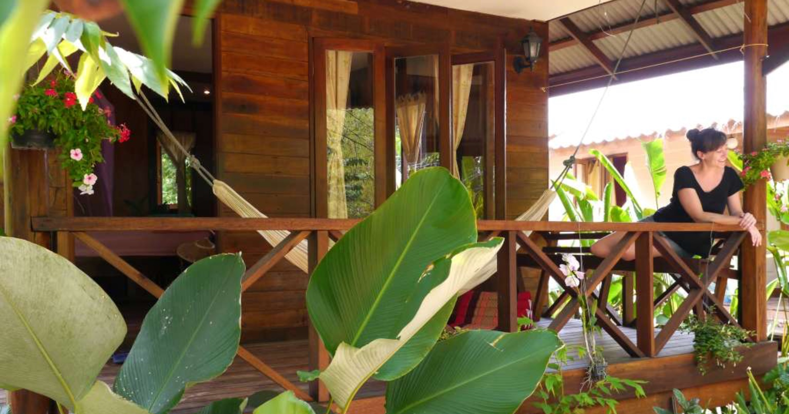 Relaxing on the porch of an island bungalow at the Koh Yao Noi yoga retreat center.
