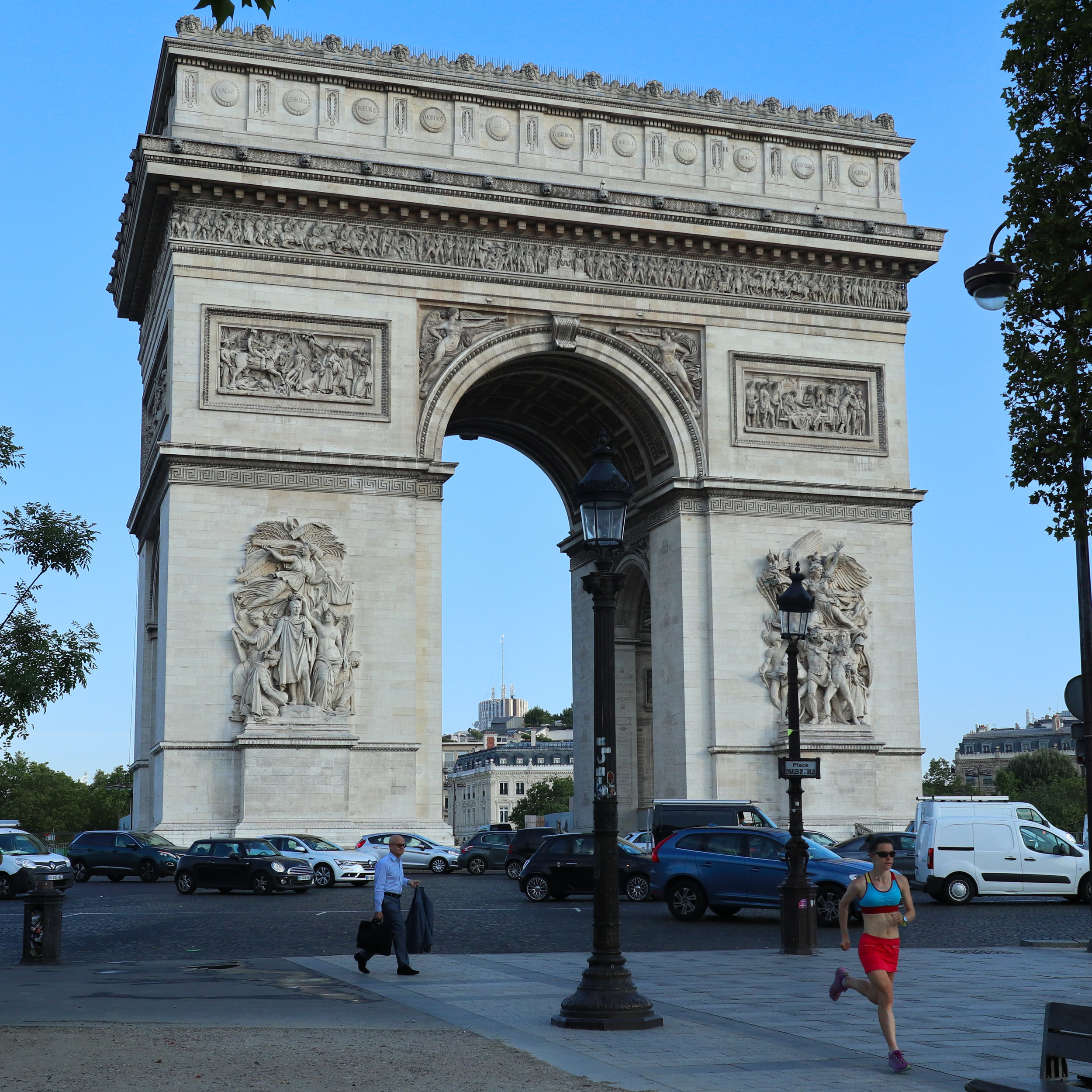 Trying not to get hit by traffic at the Arc de Triomphe.