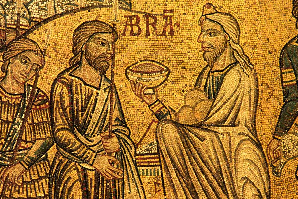 Melchizedek meets Abraham, and offers a sacrifice of Bread and Wine.
