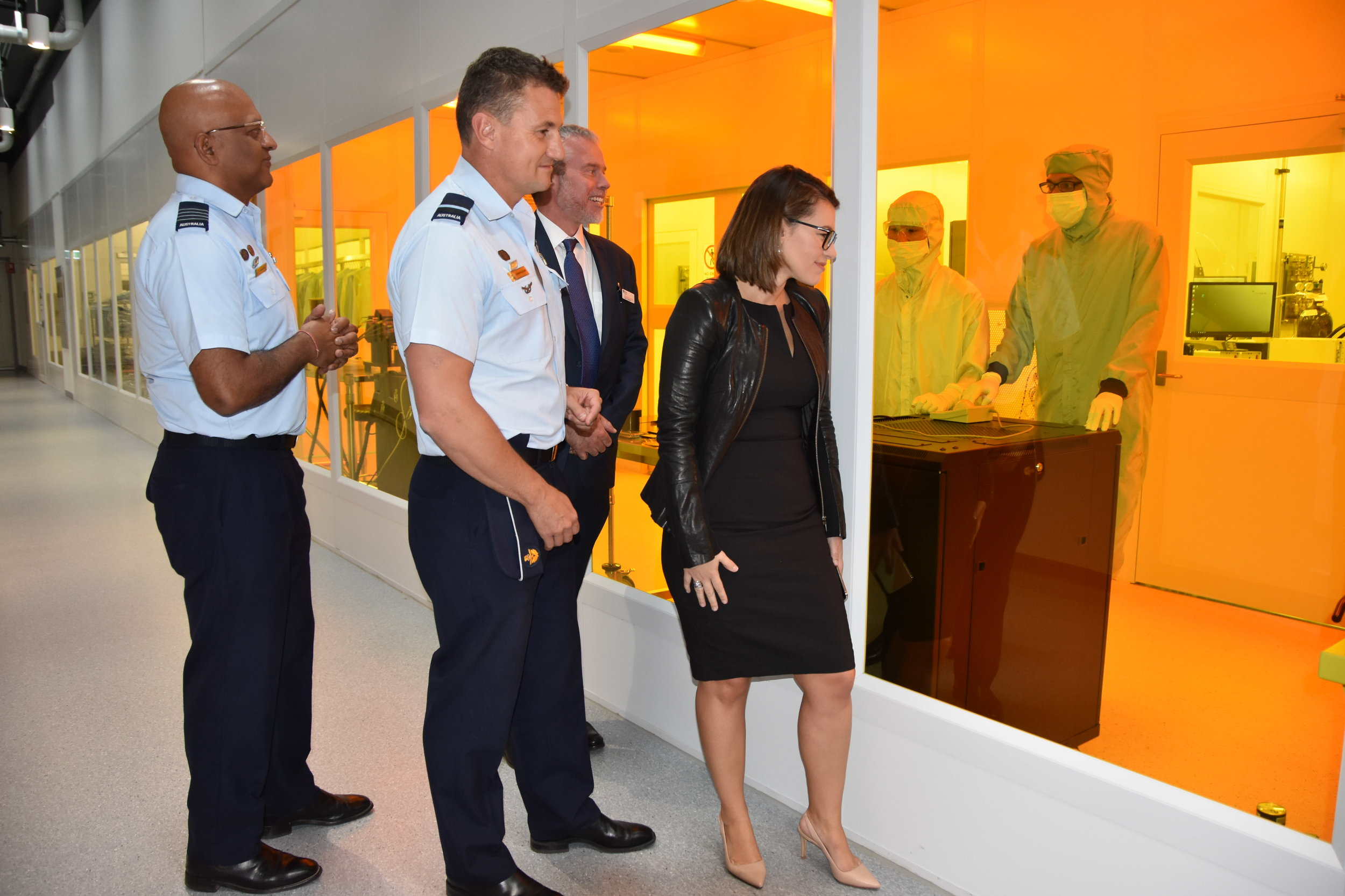 NSSN Co-Director Prof. Ben Eggleton and The University of Sydney's A/Prof Cara Wrigley show the RAAF's Wing Commander Jerome Reid and Air Commodore Darren Goldie through the smart sensing laboratories at the University of Sydney's Nano Institute