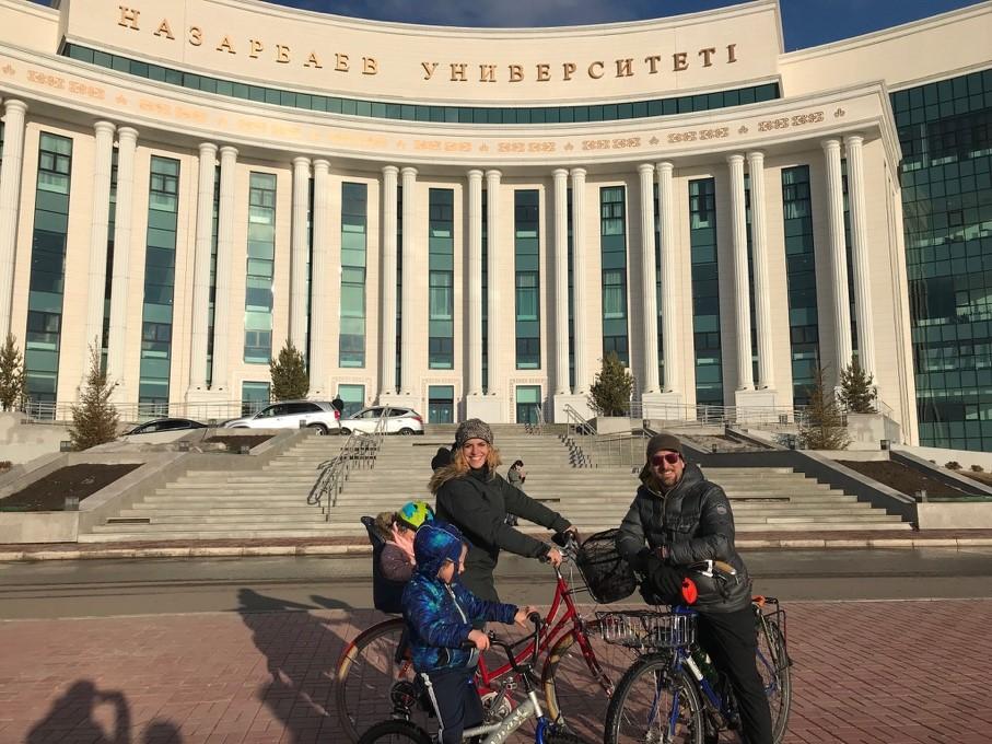 A family bike ride through campus at Nazarbayev University