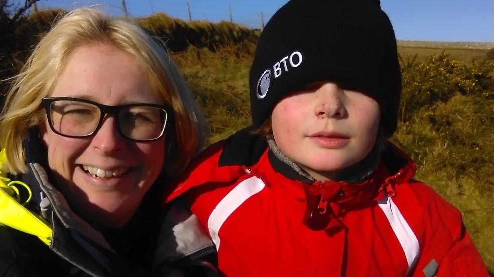 Julia Schroeder doing fieldwork on Lundy Island with her son