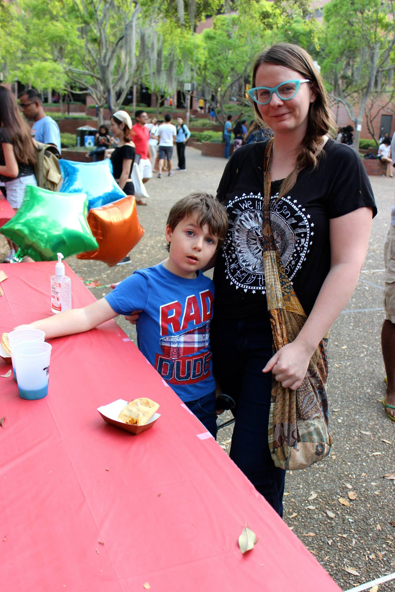 Kirsten Hecht at an event on campus with her son