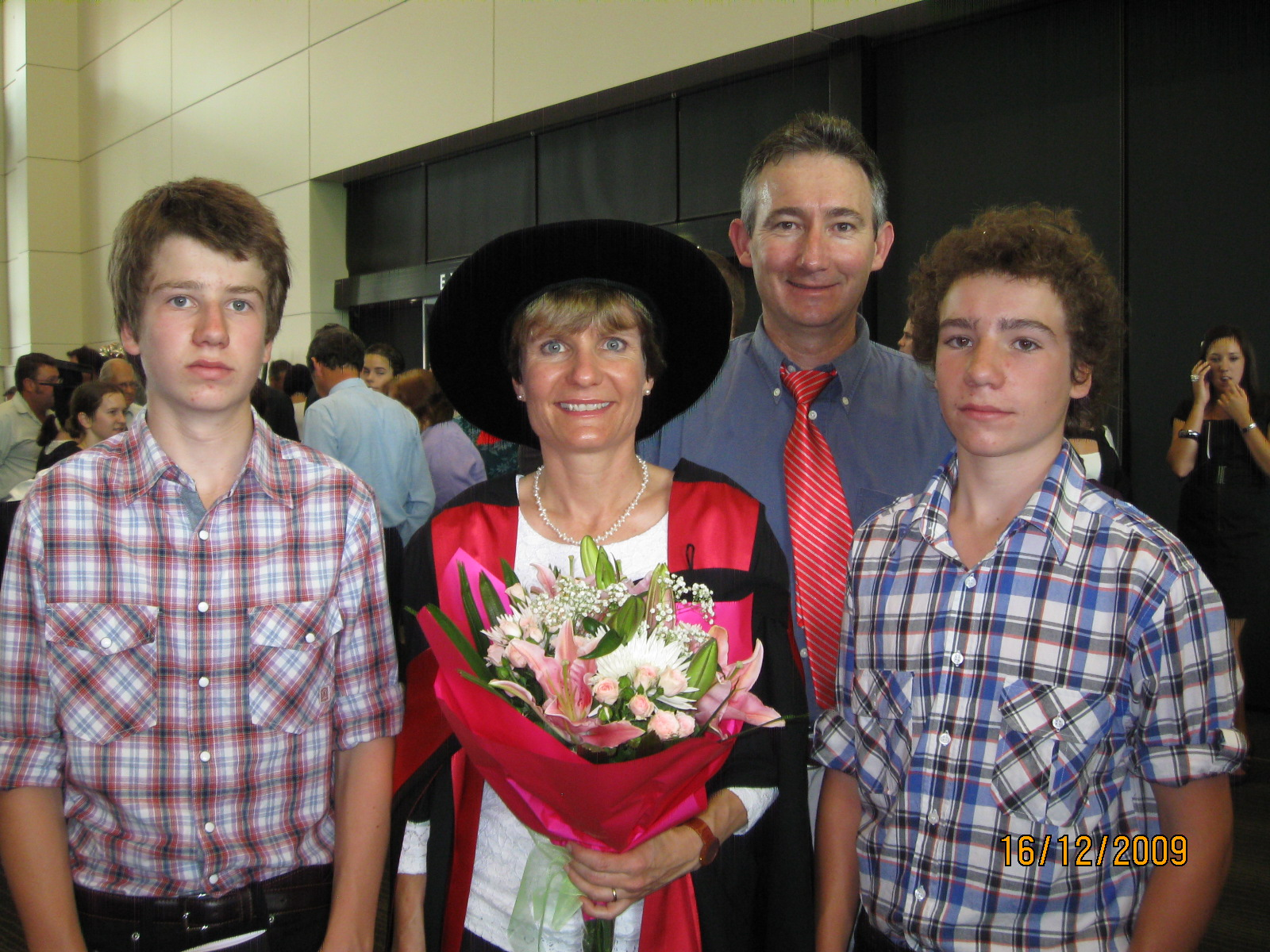 Barbara George-Jaeggli at her PhD graduation with her family