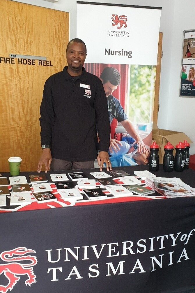 Shep manning a booth at the School of Nursing Open Day