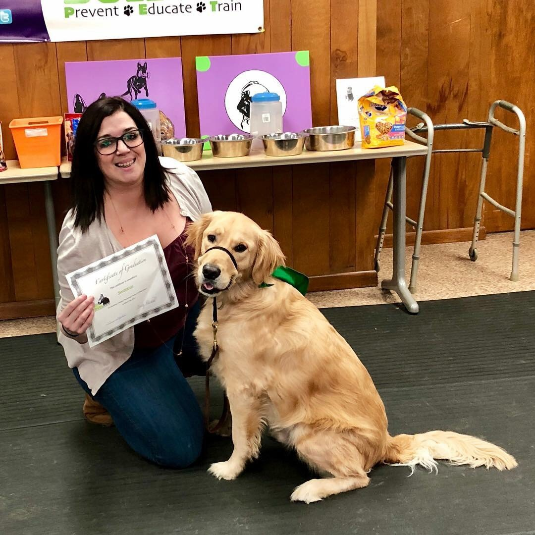 Dr. McBride Klein and Seamus following Therapy Dog Certification