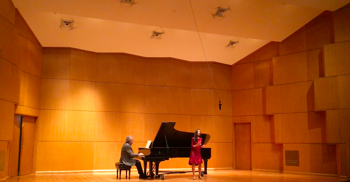 """Performing """"Caro nome"""" with voice professor, Robert Grayson"""