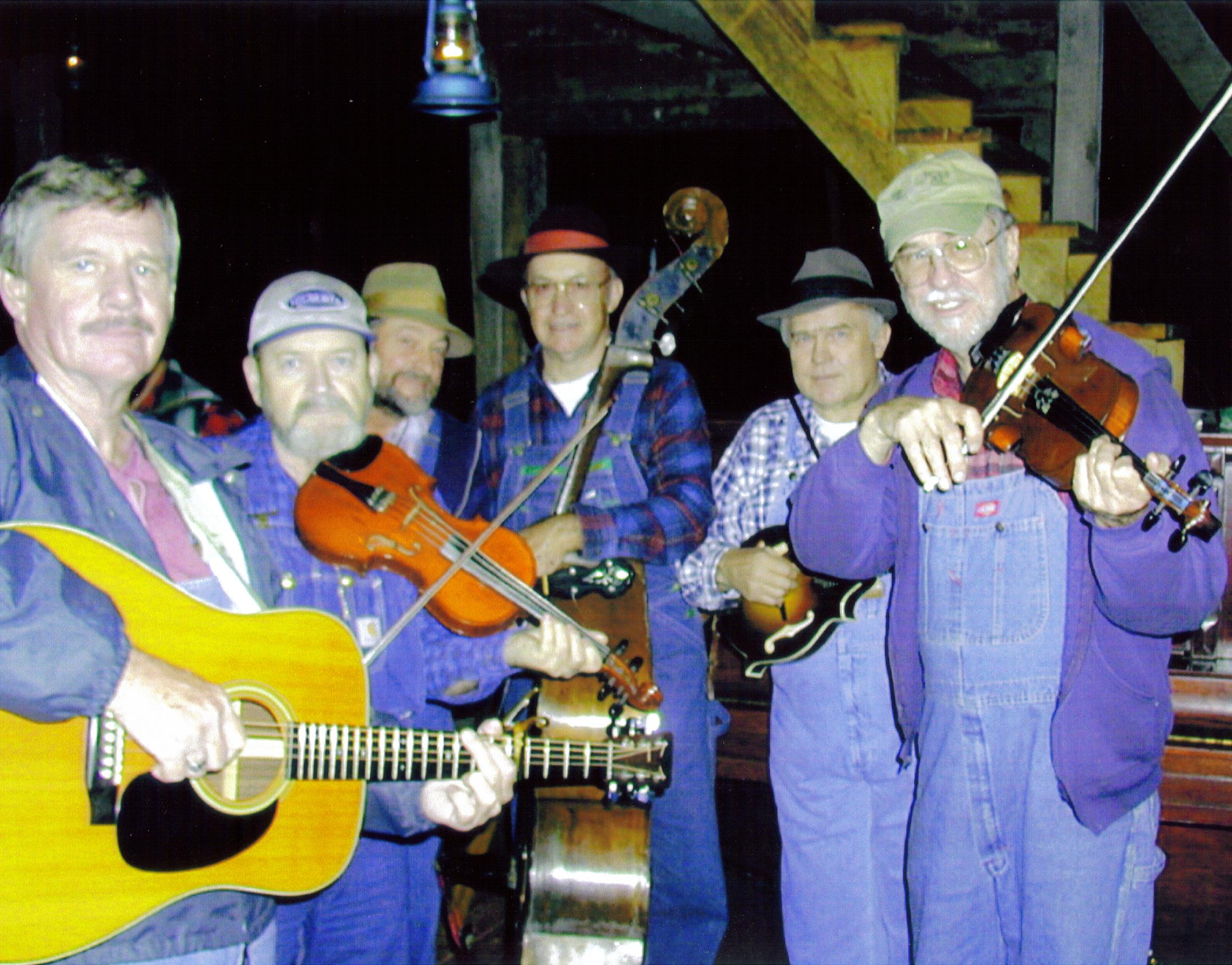 The Kentucky Clodhoppers in their prime: L. C. Johnson, Billy Don Stamper, Earl Thomas, Jr., Glyndon Watson, Donnie Rogers, John Harrod. This was the favorite old time dance band at Meadowgreen Music Hall at Clay City, KY for many years.
