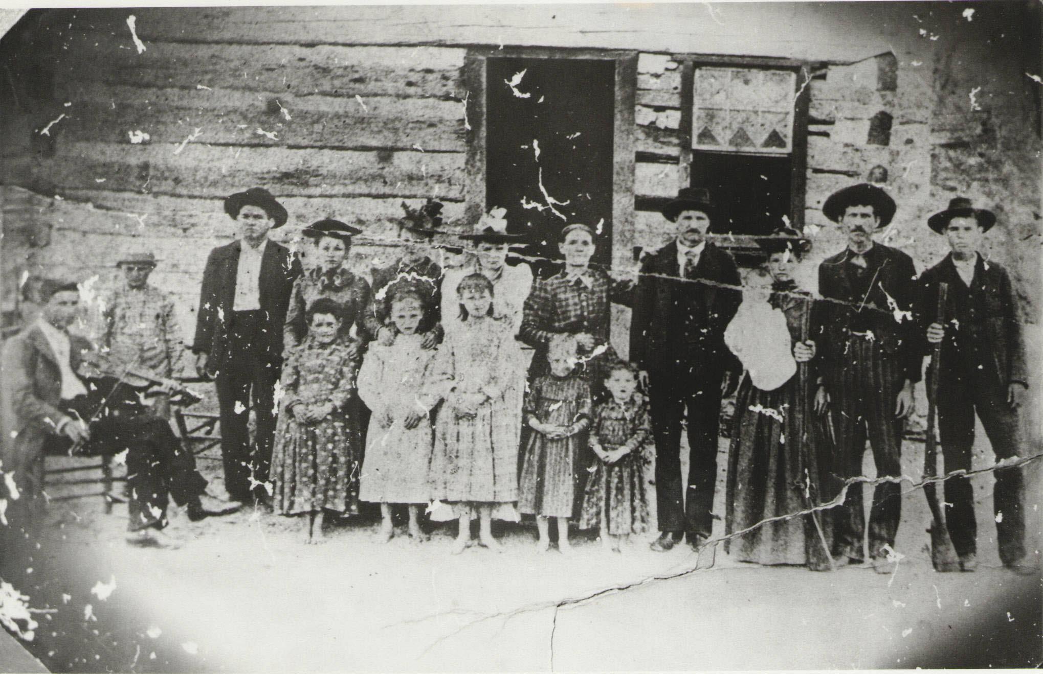 Peggy John Harrod family, Bald Knob, Franklin Co., KY, 1892. Lee Harrod with fiddle.