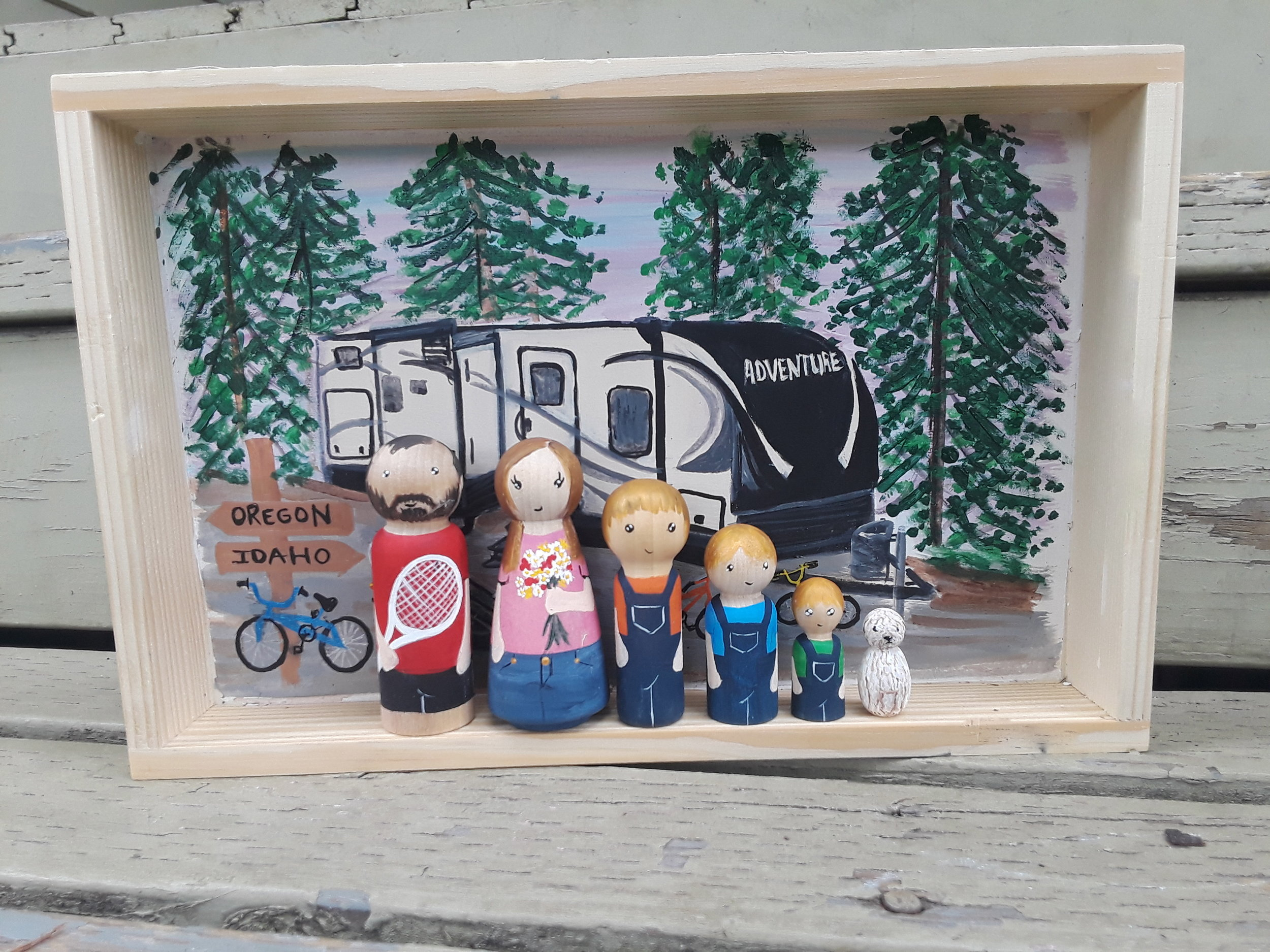 RV Adventure Life - This family wanted to have a special Shadow Box that would represent their adventurous life living in an RV. They wanted their kids to always remember and treasure the great times they experienced together living their own adventure. They decided to add the kids bikes to the Shadow Box. Dad is a tennis coach and mom always receives colorful flowers from her sweet three boys. Of course, their furry friend is also part of the family portrait.Box size 8x12 inches. 6 pegsStarts at $165