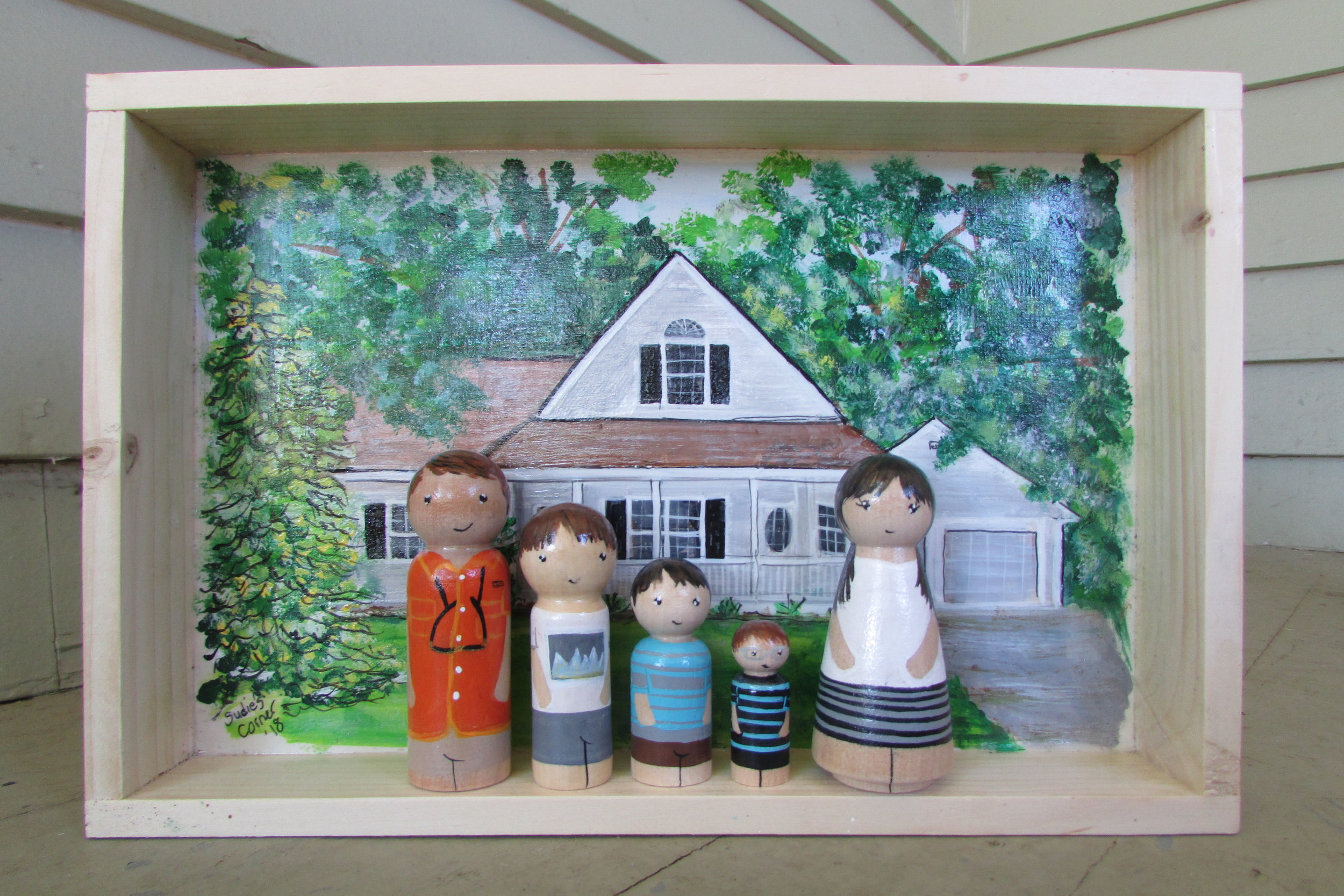 House Warming Gift - This Shadow Box is a sweet house warming gift for this little family as they start a new adventure in a new town and a new house. A promise of many memories to be made in this beautiful home.Box Size 8x12 inches. 5 peg dolls. Starts at $150