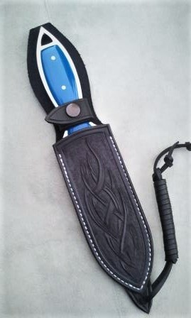 Kali fighter with blue G10 in sheath marcos.jpg