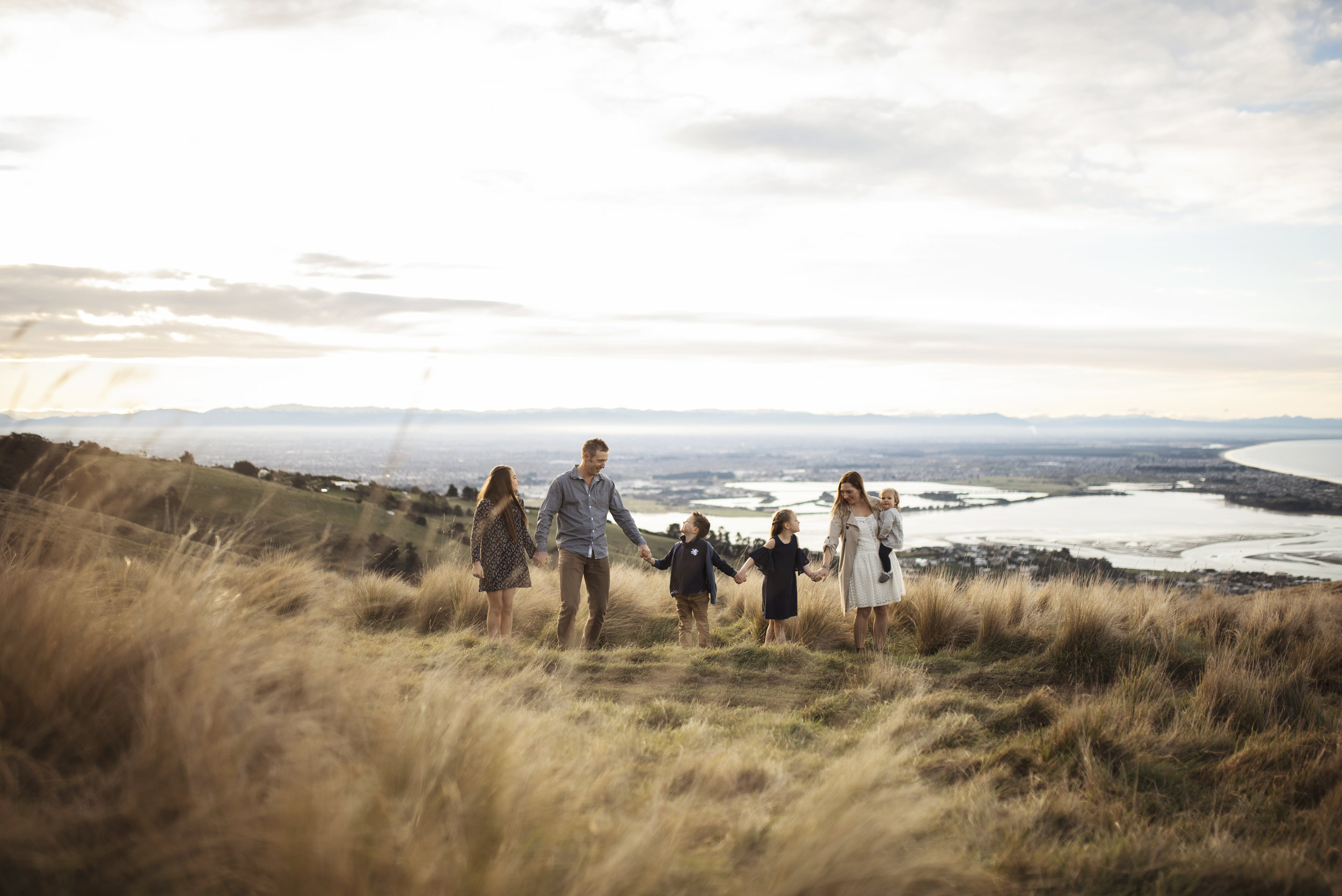 Seattle family photographers family of six standing on a hill