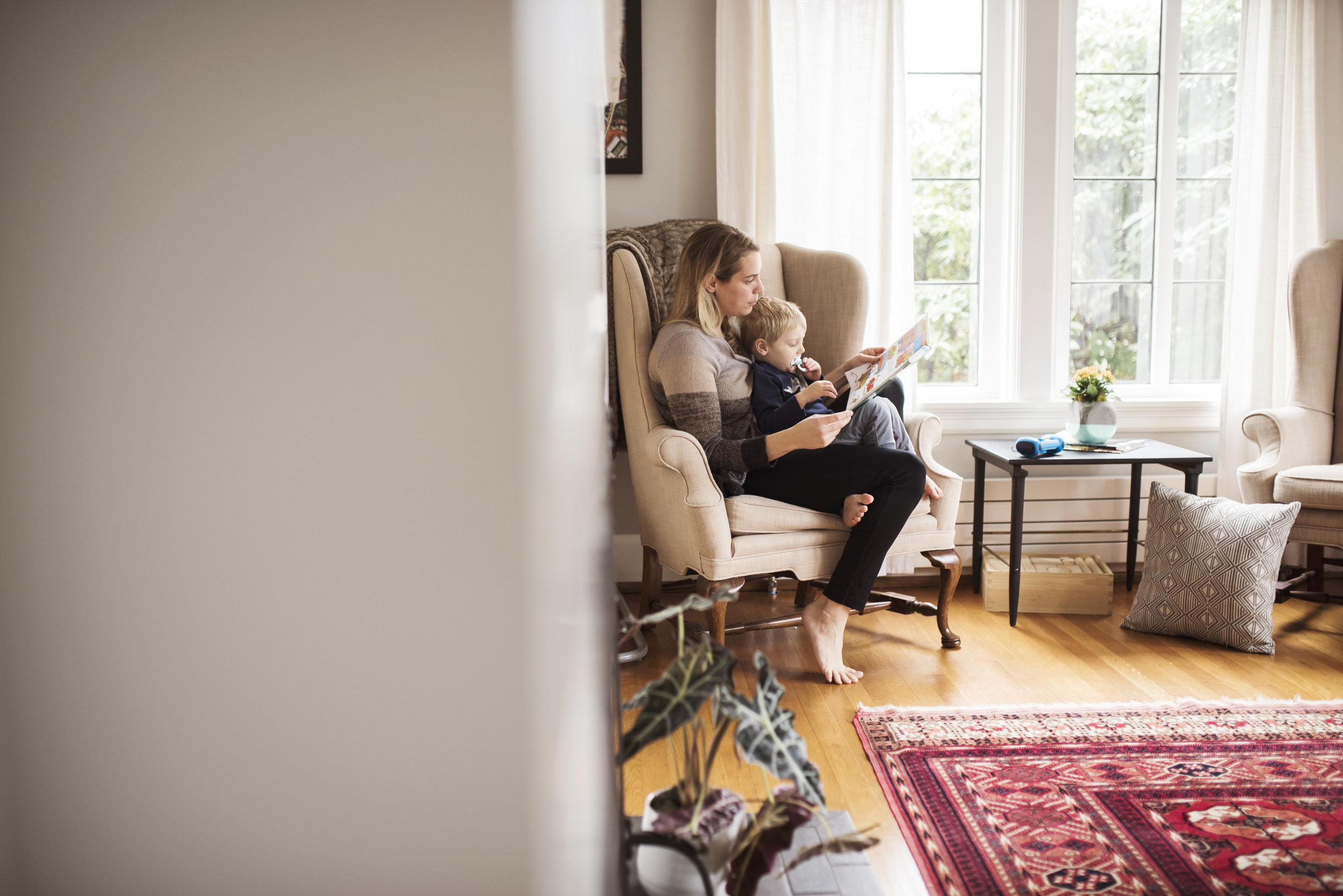 Seattle family photography mom is reading to son at home
