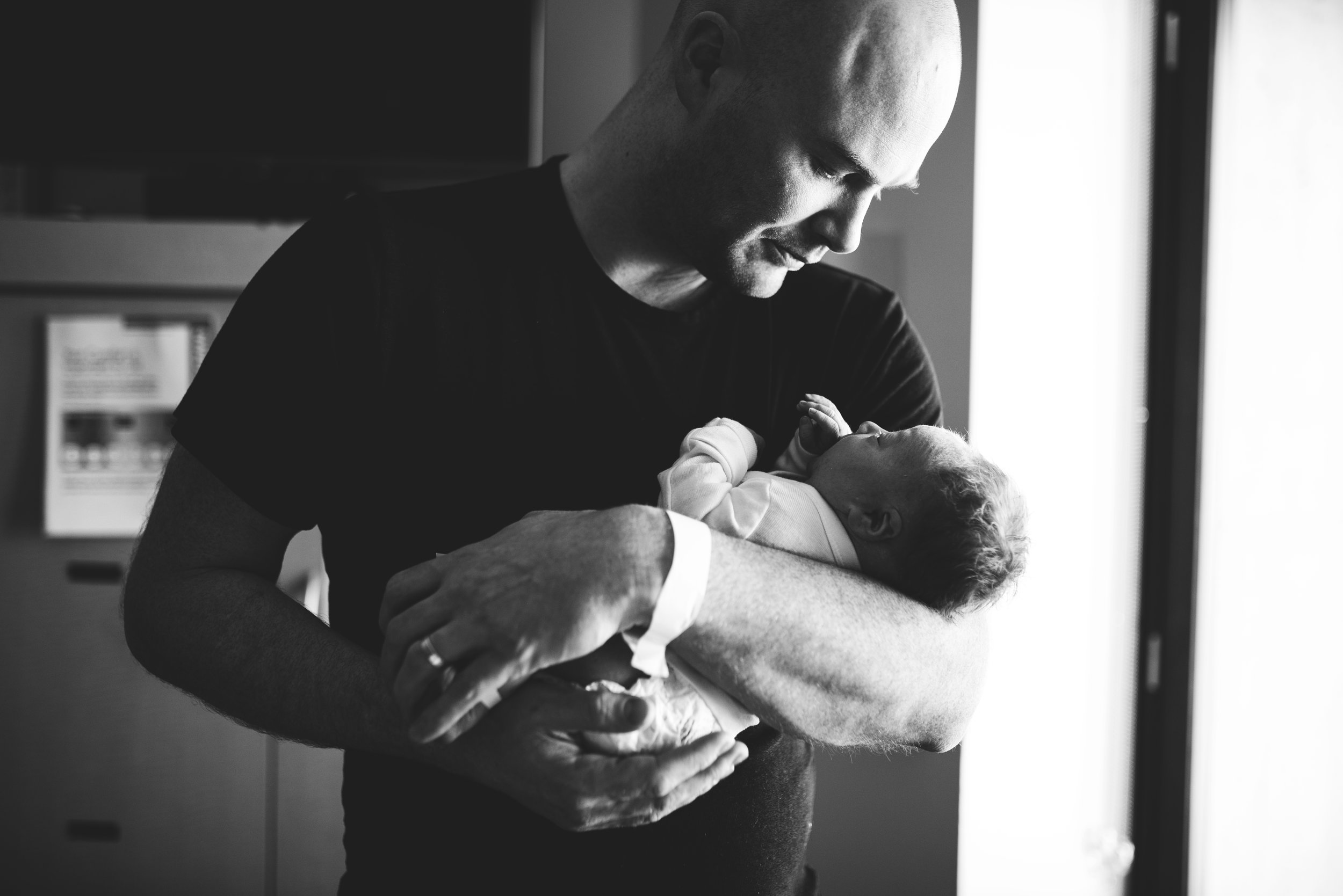 Seattle Lifestyle Photographer baby in dad's arms at hospital