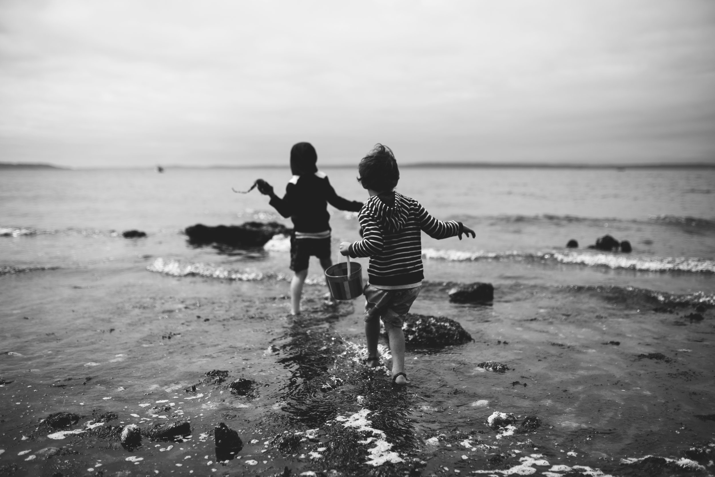 Seattle lifestyle photographer two boys are playing at the beach