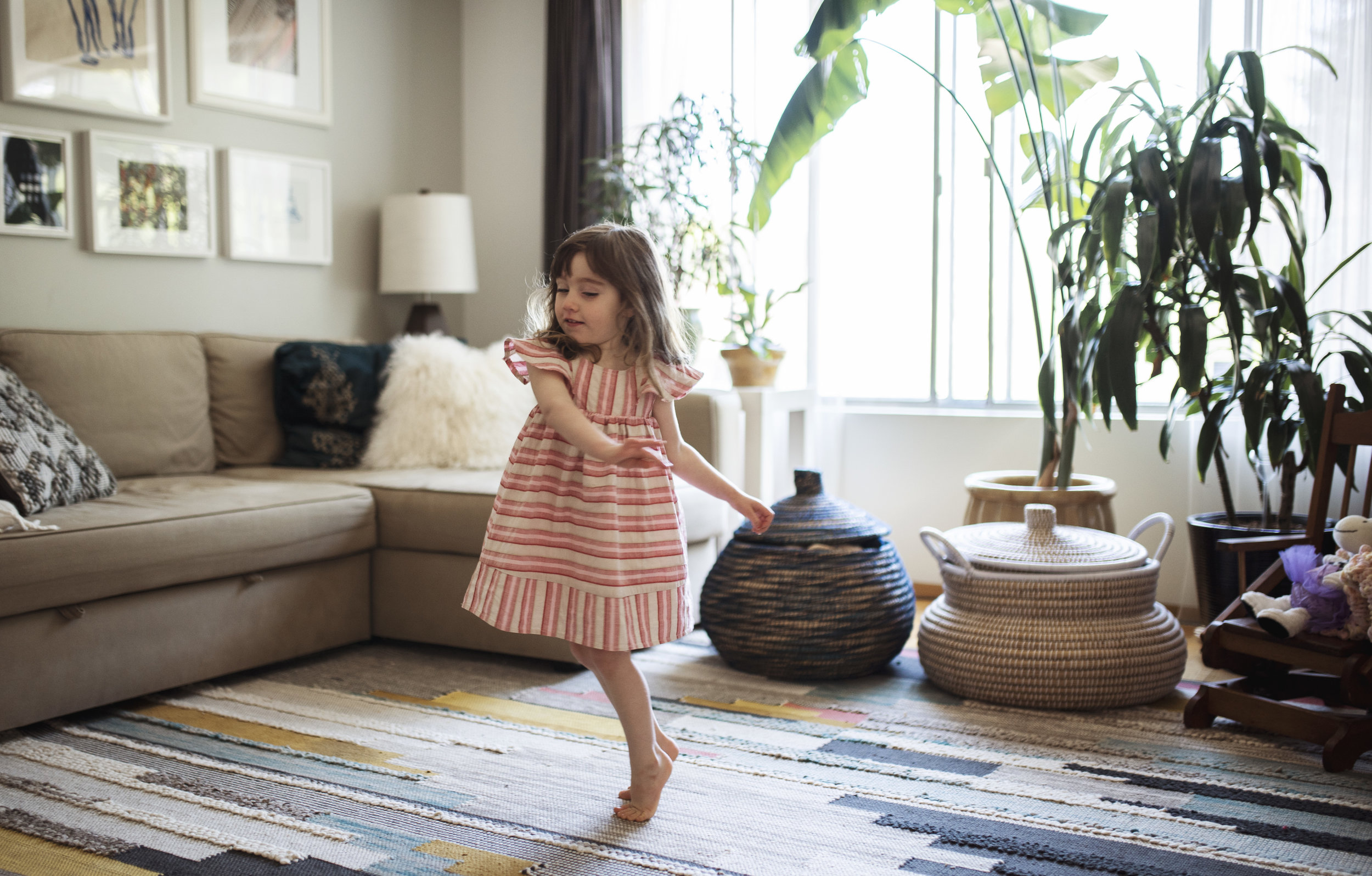 Seattle lifestyle photographer girl is dancing in living room