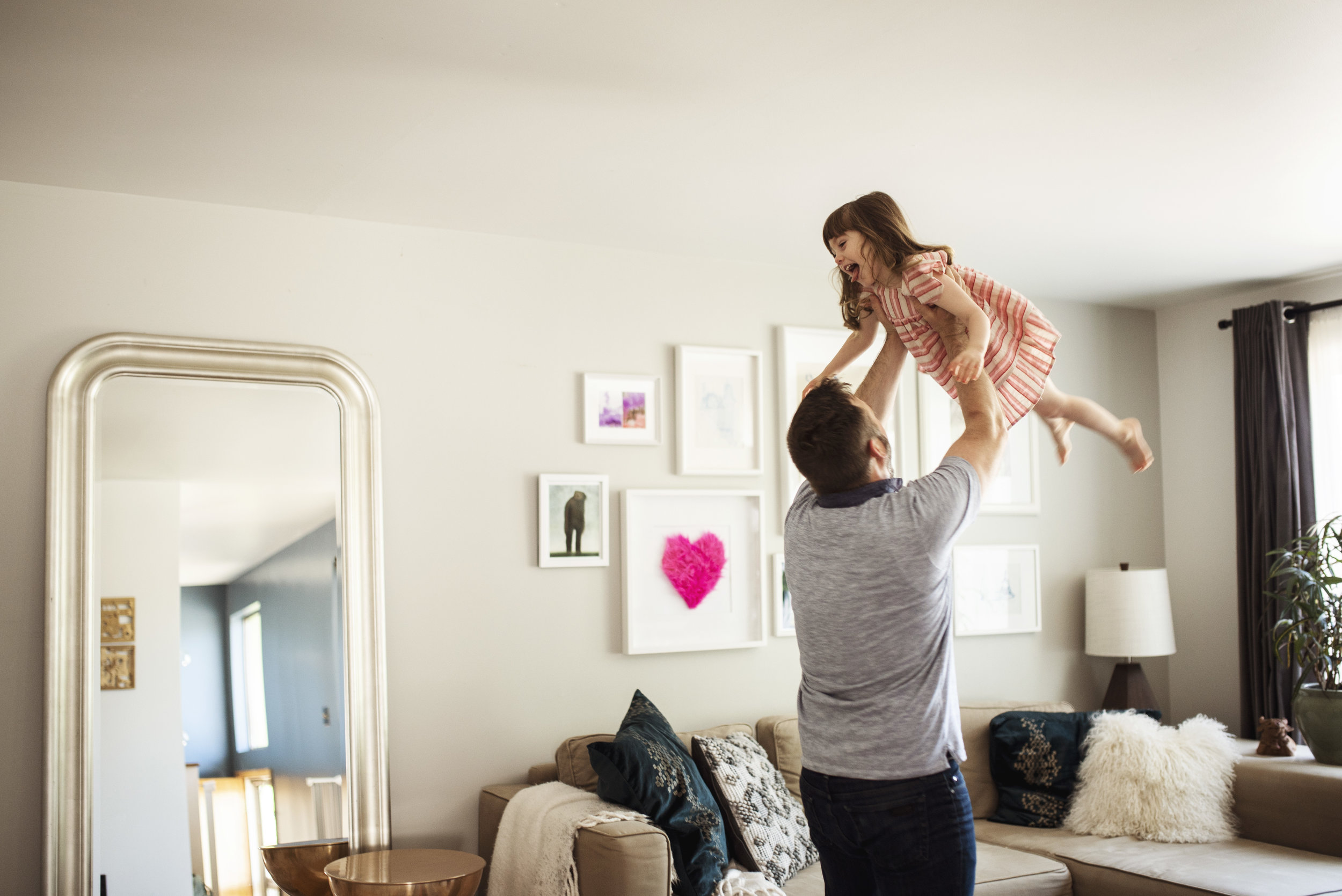 Family photographer Everett dad is flying little girl in the air