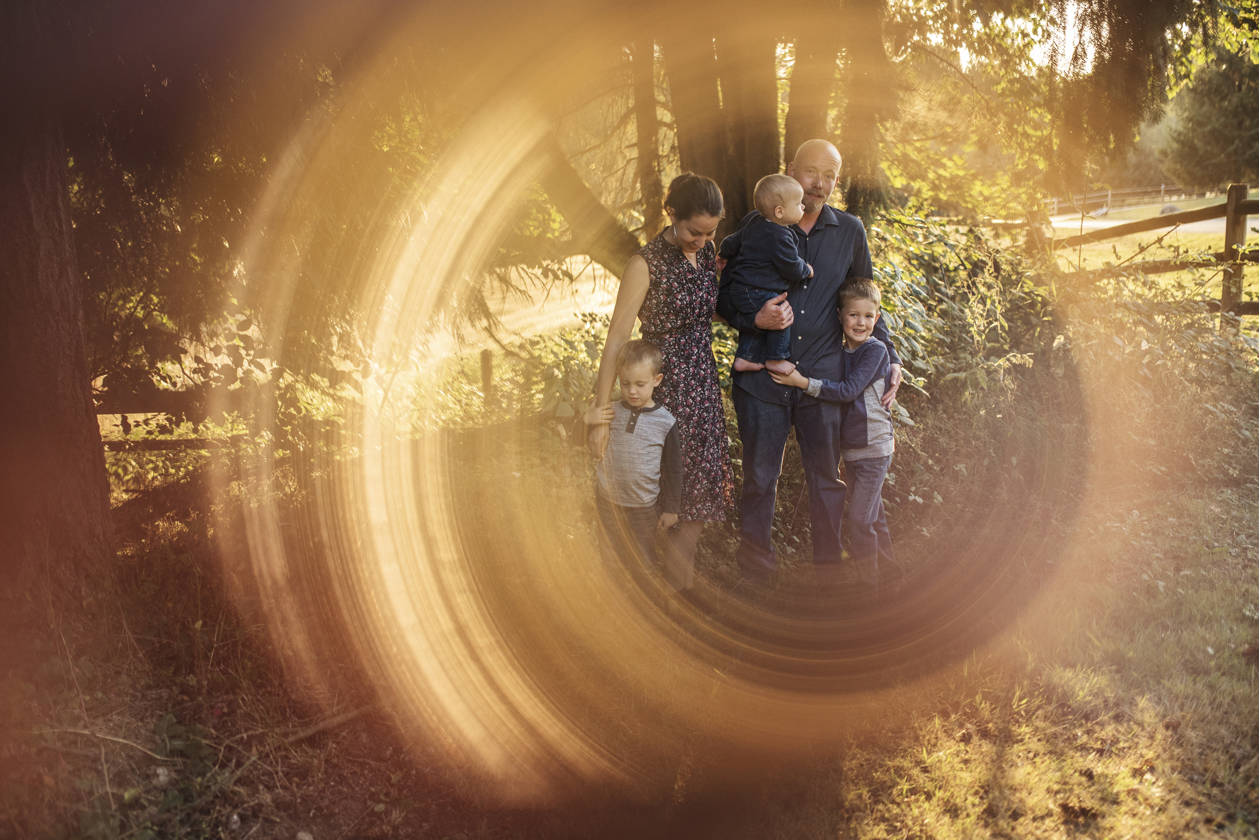 Edmonds family photographer family standing together with ring of fire camera effect