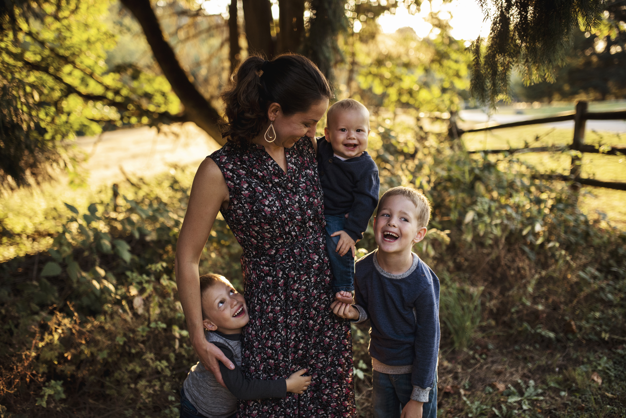 Seattle lifestyle photographer mom is standing with her three sons