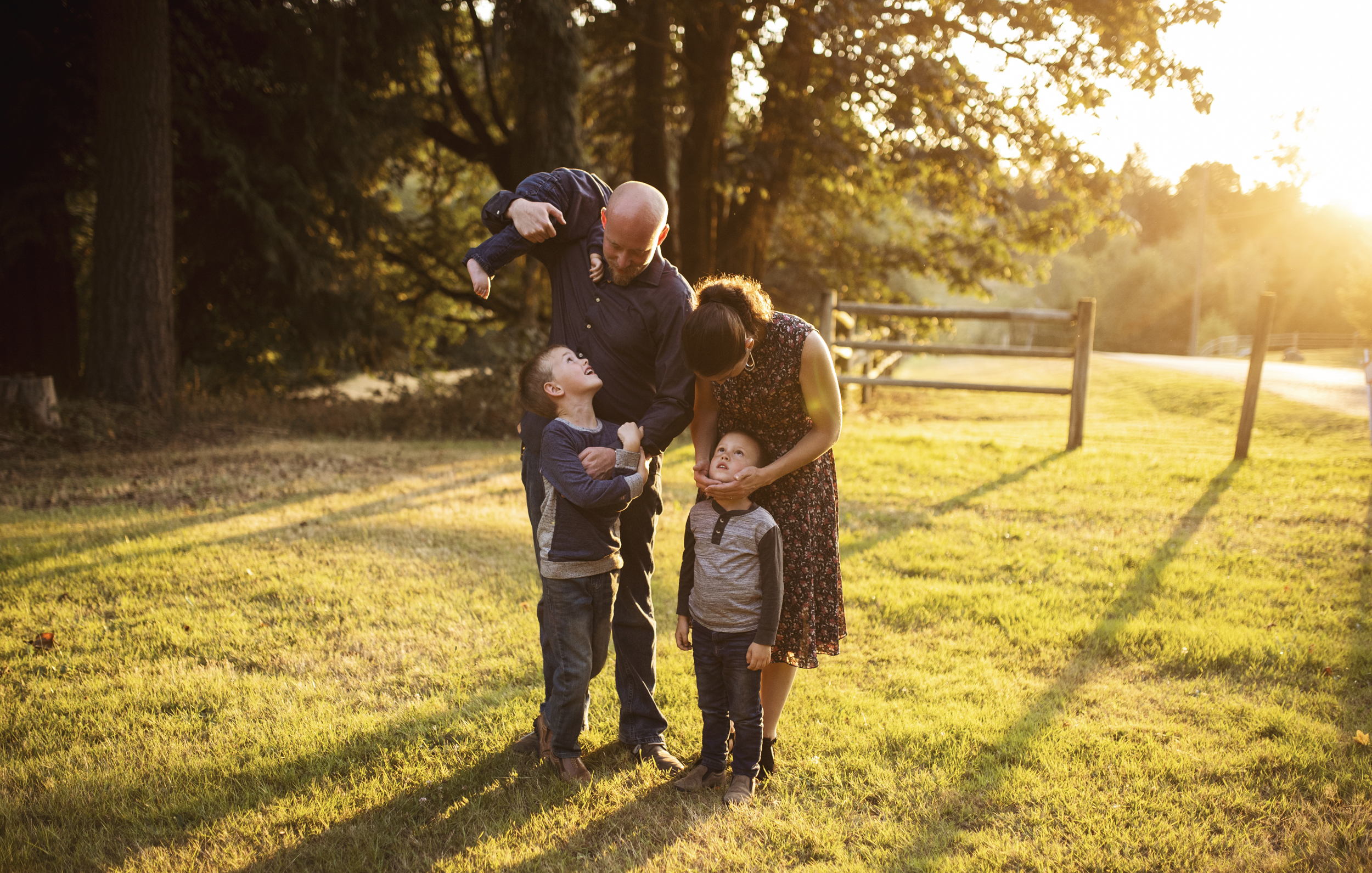 Edmonds lifestyle photographer family is standing together playing