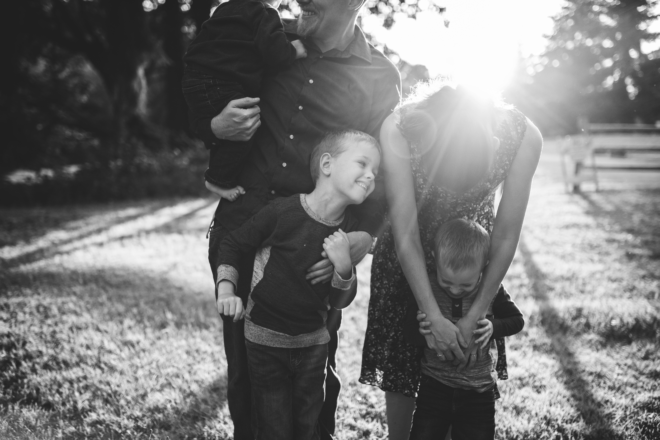 Seattle lifestyle photography family is standing together cuddling in black and white