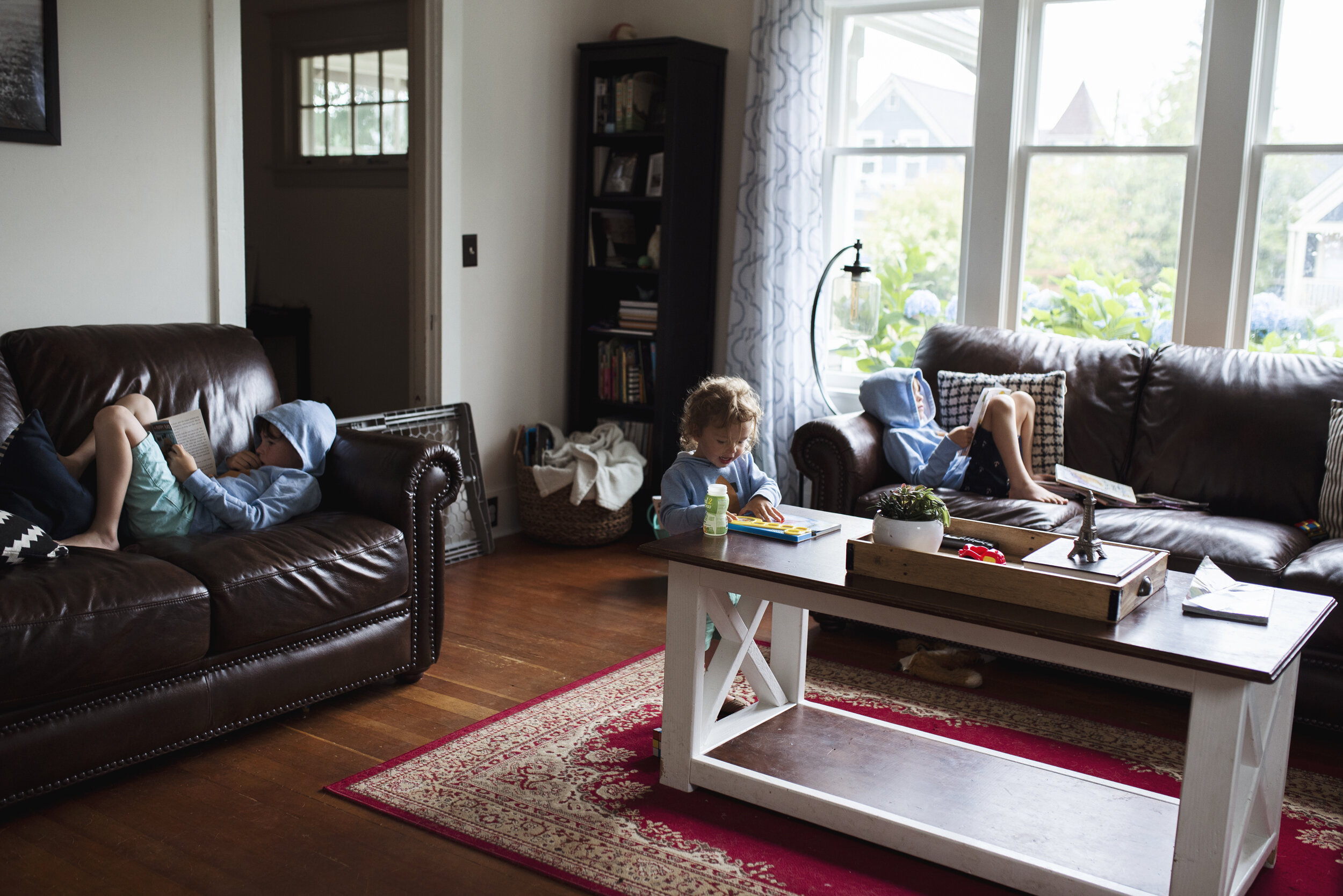 Seattle family photographer boys reading in living room