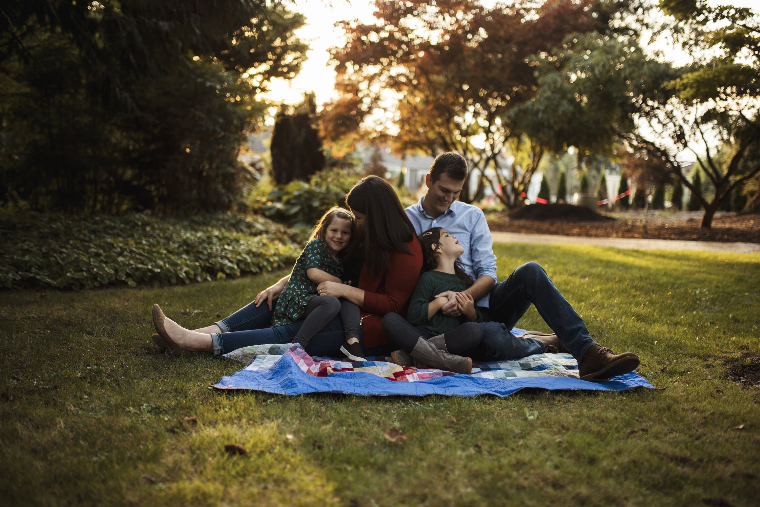 Seattle lifestyle photographer family snuggling together on blanket