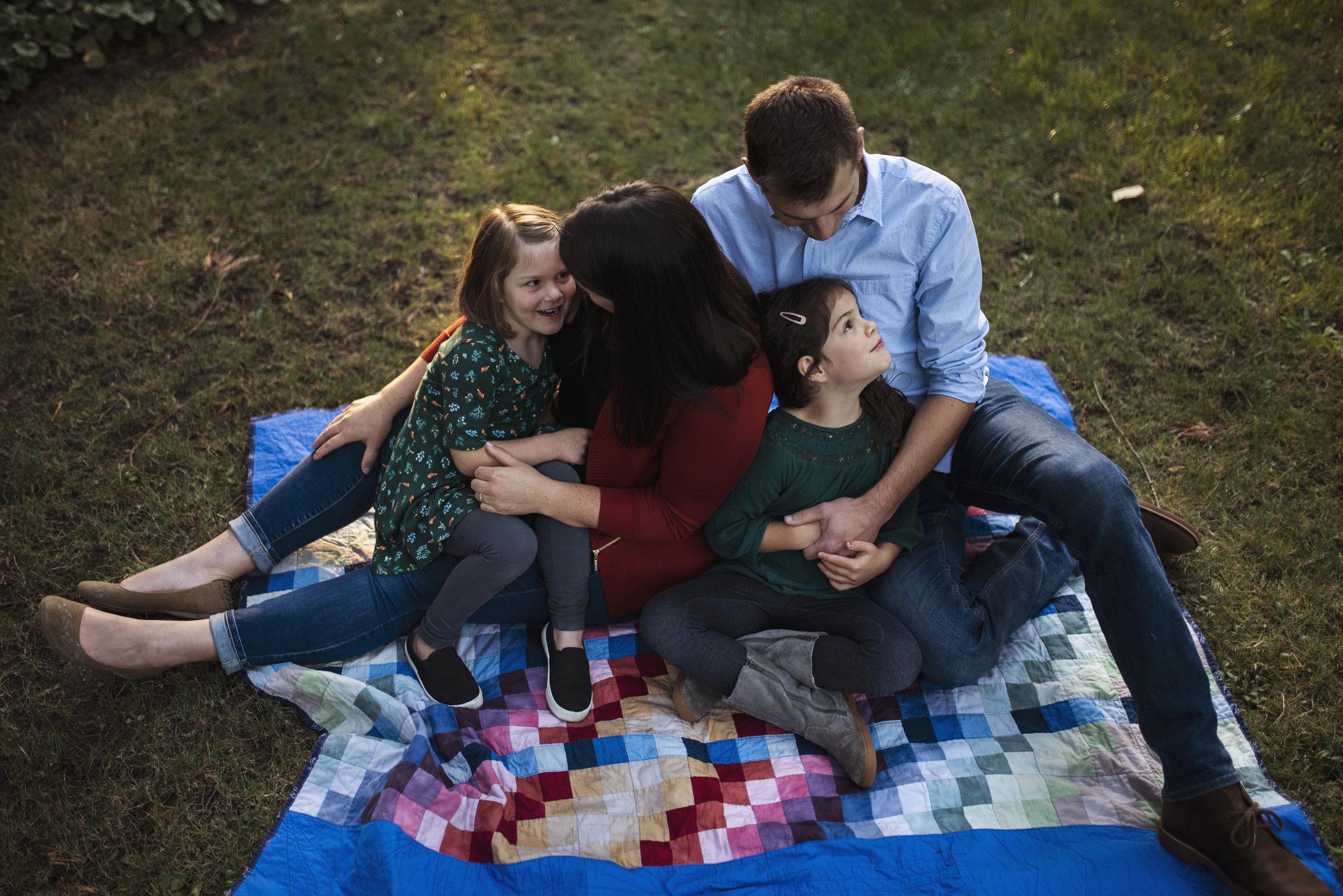 Edmonds family photographer family together on blanket