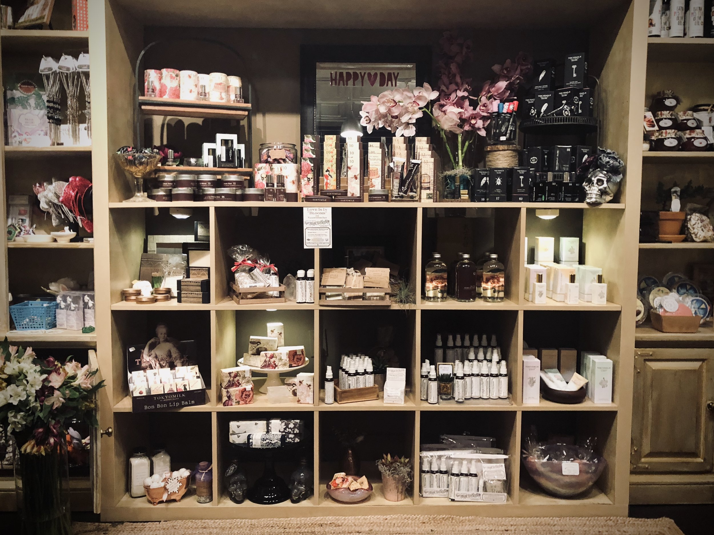 Our Bath & Body wall, includes TokyoMilk, Root, Branch & Blossom, Lovewild Design.