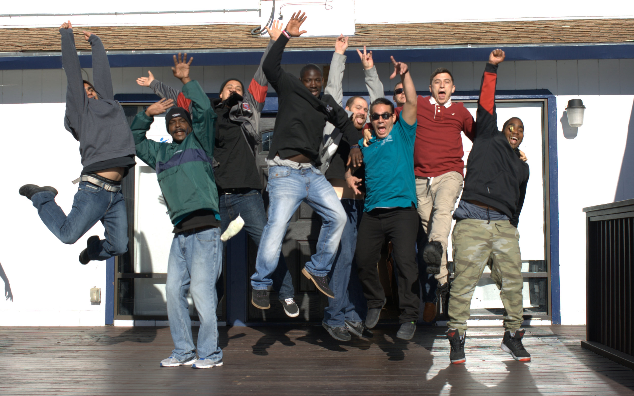 Teen Challenge NorCalWest Nevada men celebrating recovery outside the Oakland Men's Center.