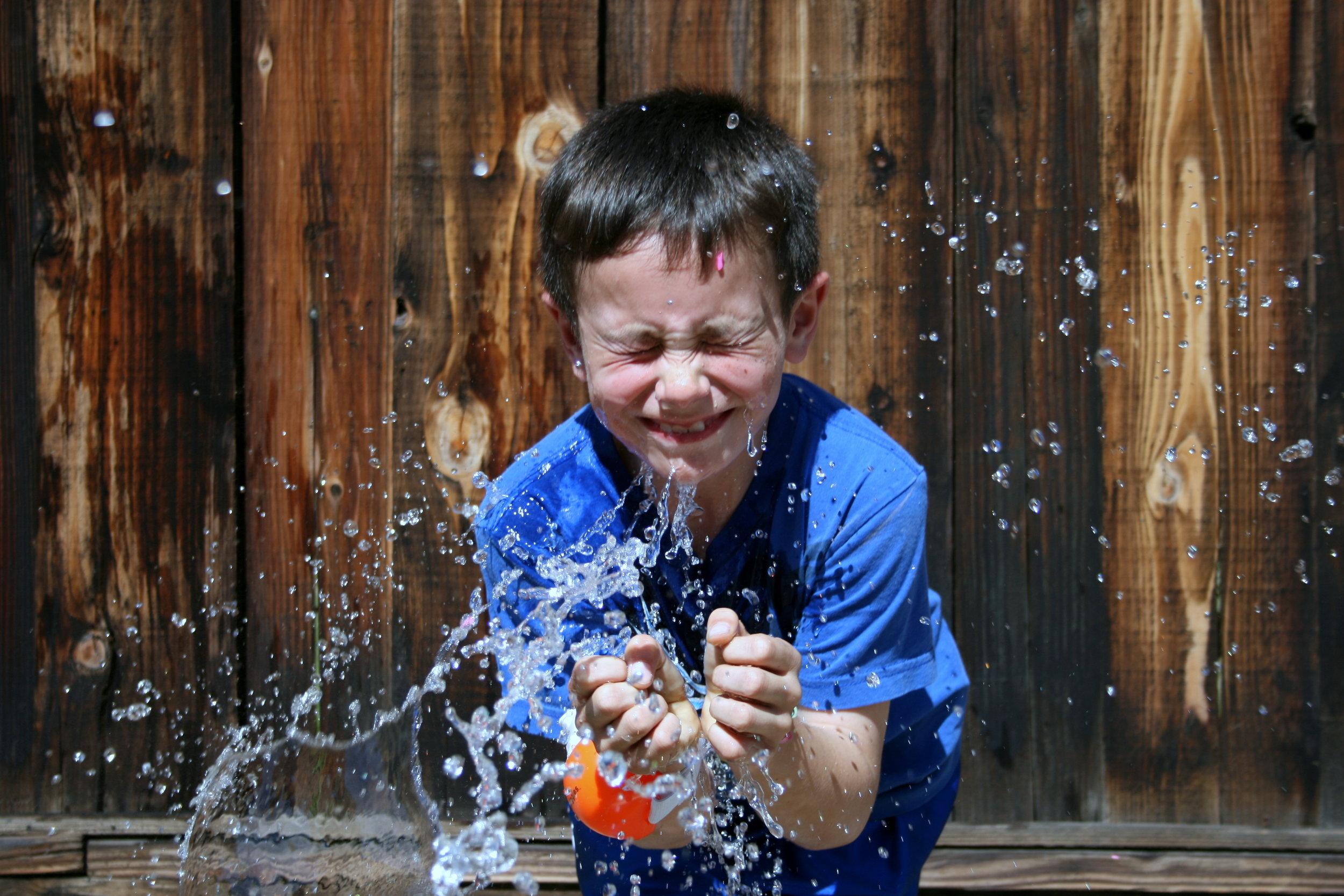 Child splashing at Alum Rock Women and Children's Center