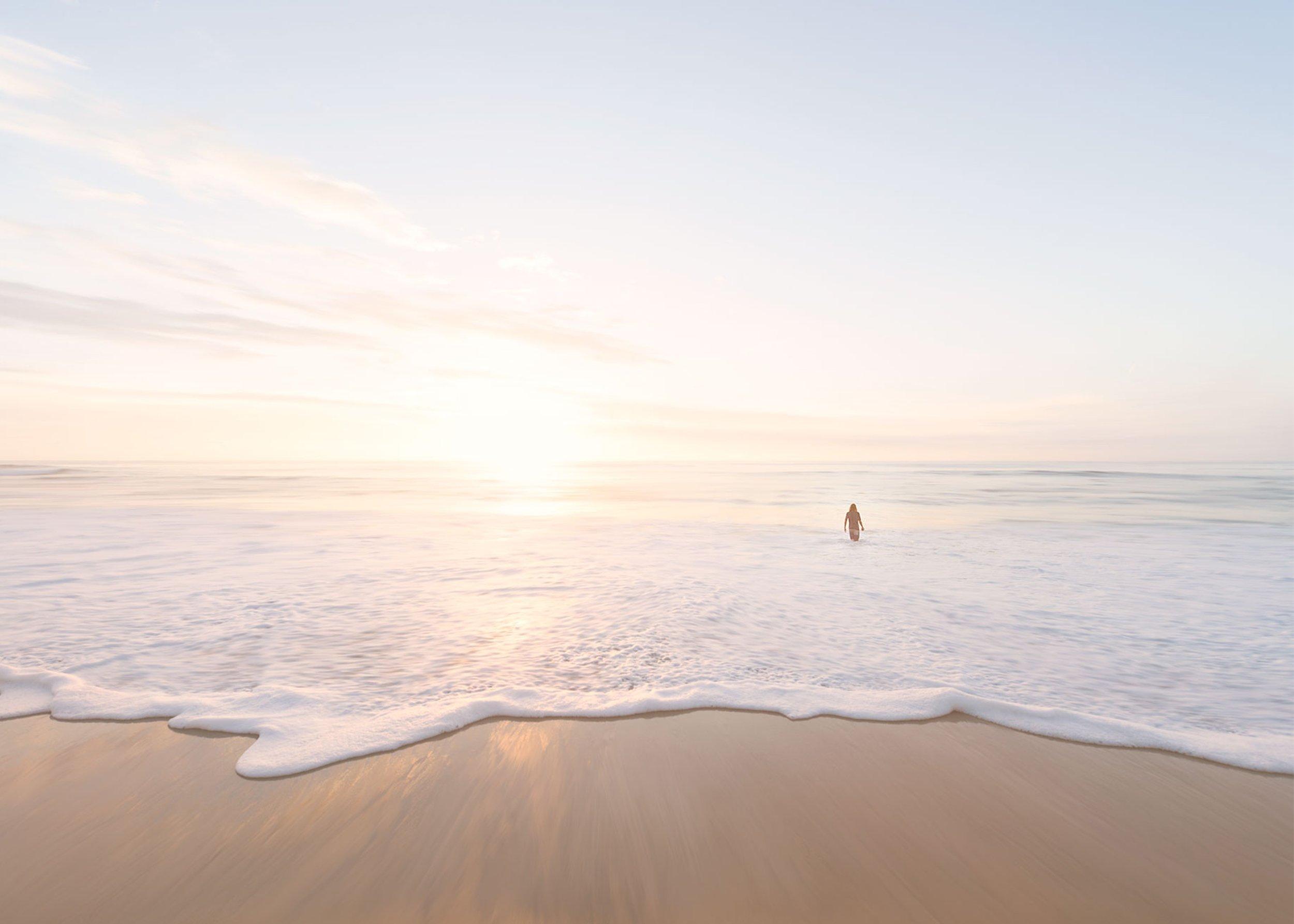 person walking in ocean.jpg