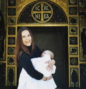 Me, holding my son, on the day he was baptized.