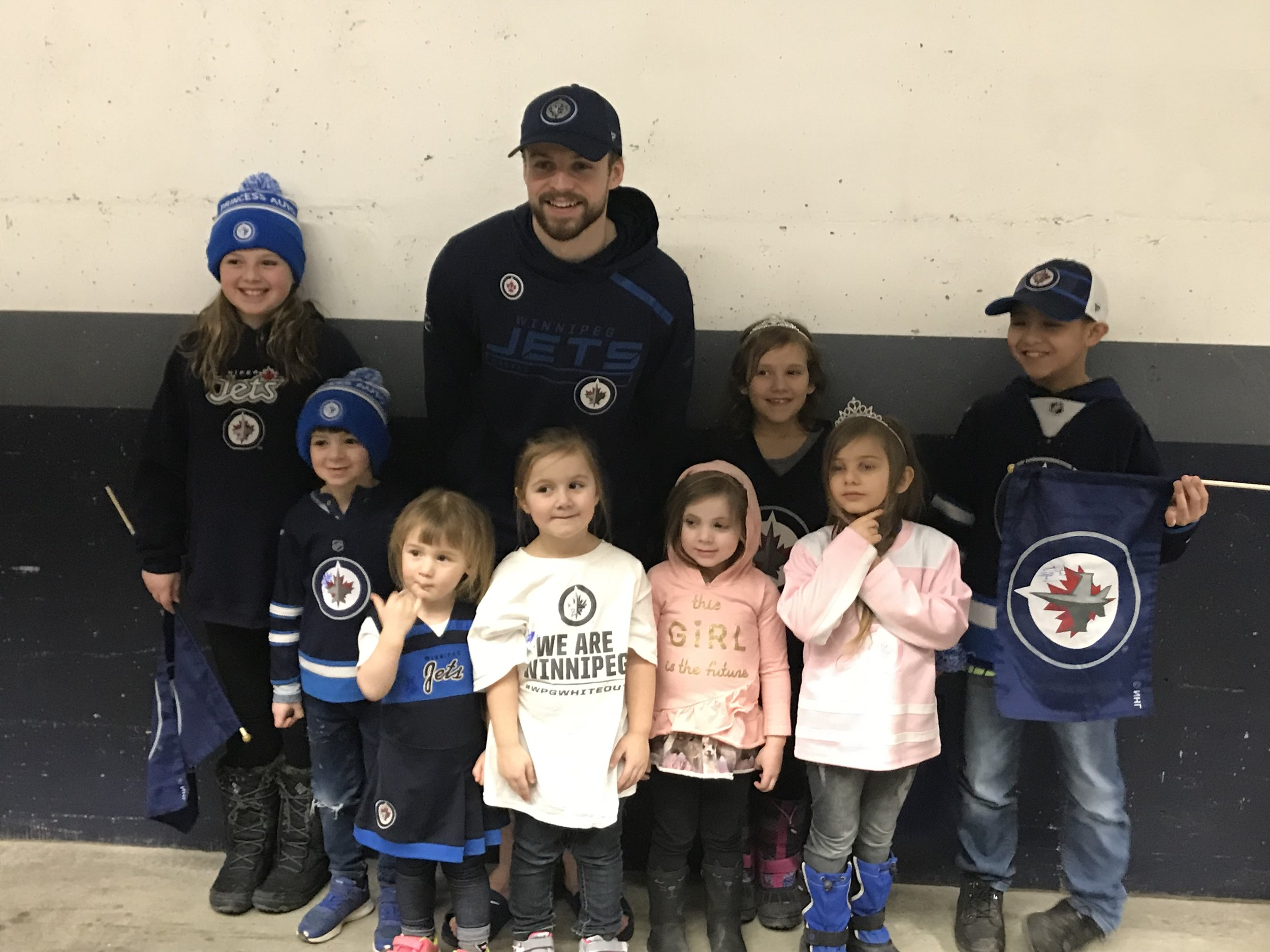 Pictured: Josh takes time to meet and greet a wonderful group of Dream Kids after a Winnipeg Jets game