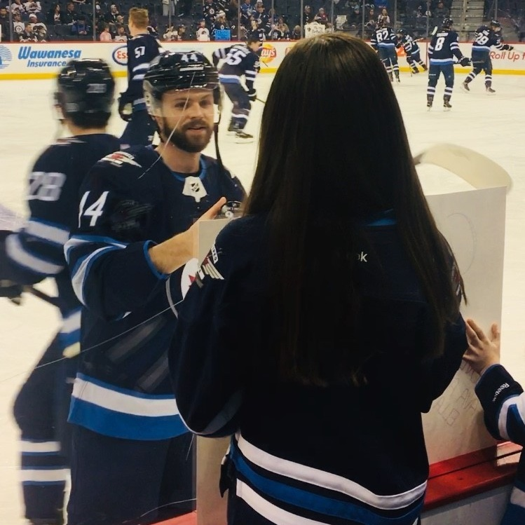 Pictured: Josh takes a moment during warm-up to say hi to Dream Kid Ava and her sister, Ella.