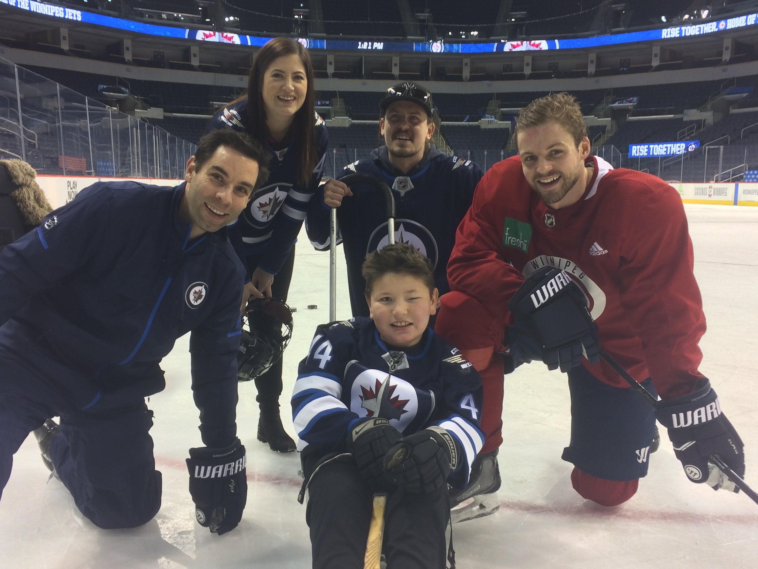 Pictured: Dream Kid Zack was all smiles when he took to the ice with his hockey hero, Josh Morrissey