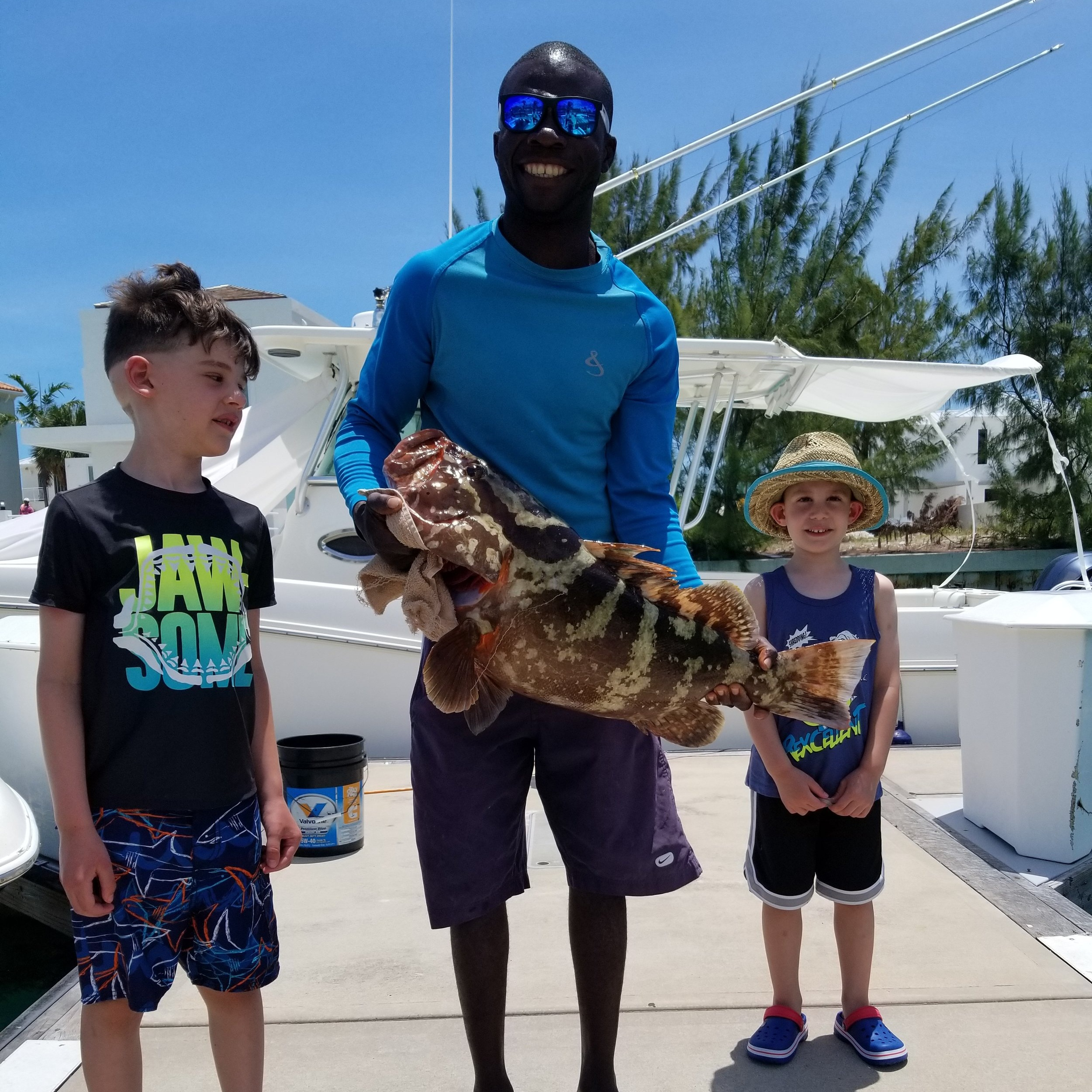 Pictured: Nathan  and his brother enjoying a dream fishing excursion in Turks and Caicos!