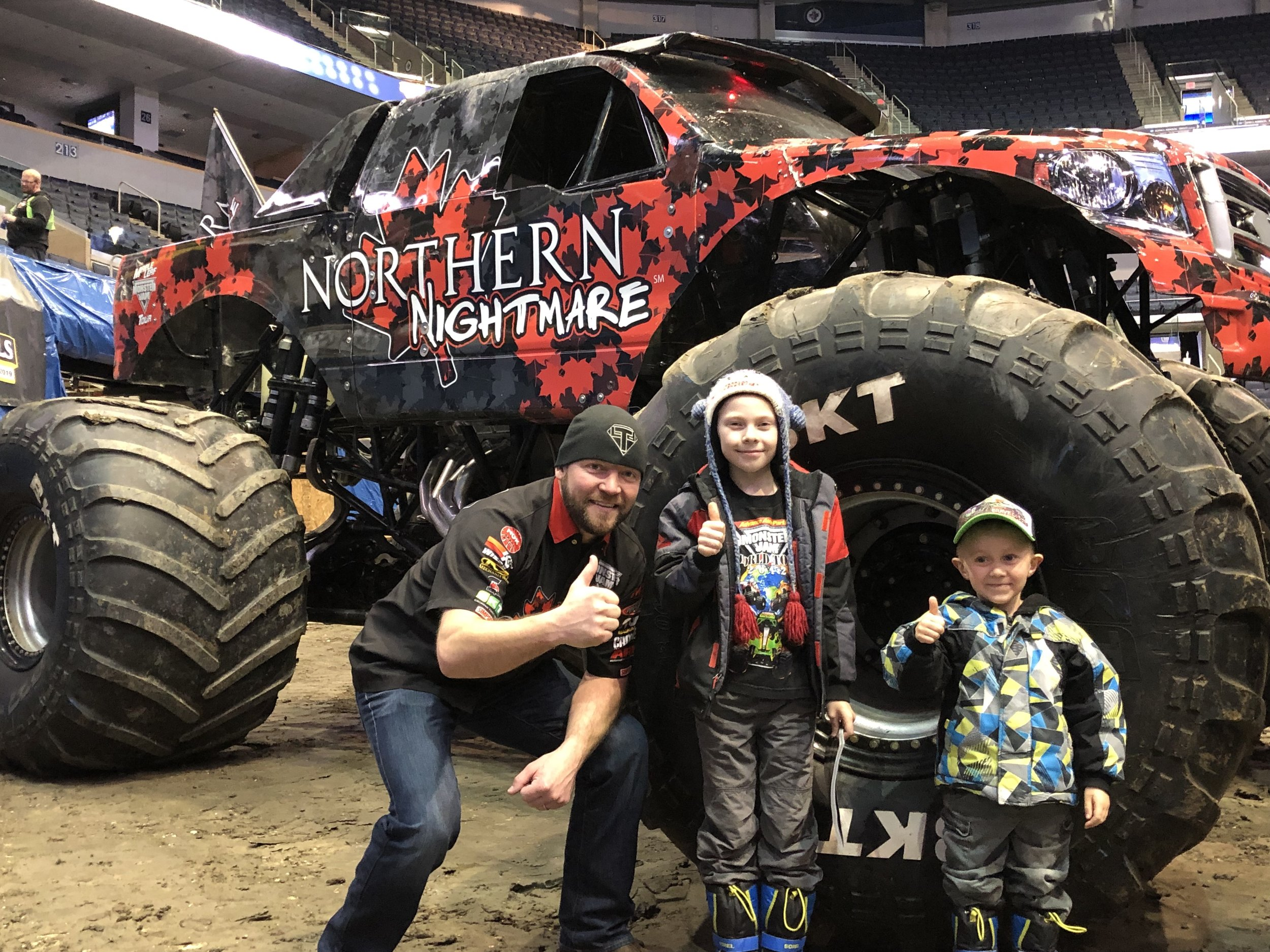 Pictured:  Dream Kid  Colten  and his brother enjoying a special Meet + Greet with one of the drivers of  Monster Jam .