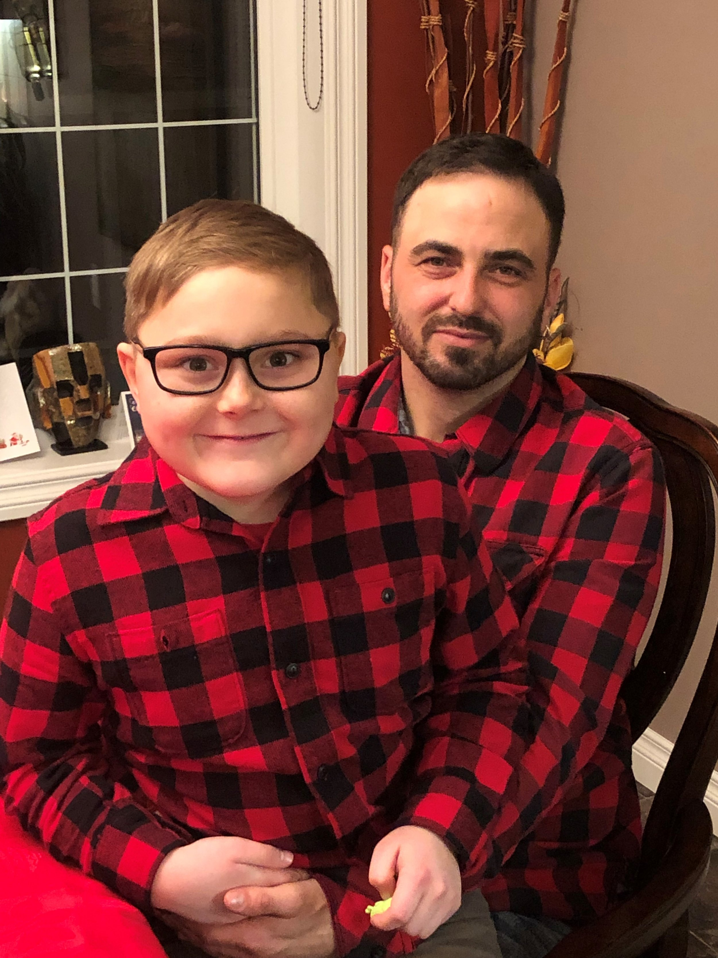 Pictured: Holdyn  and his dad matching in plaid!