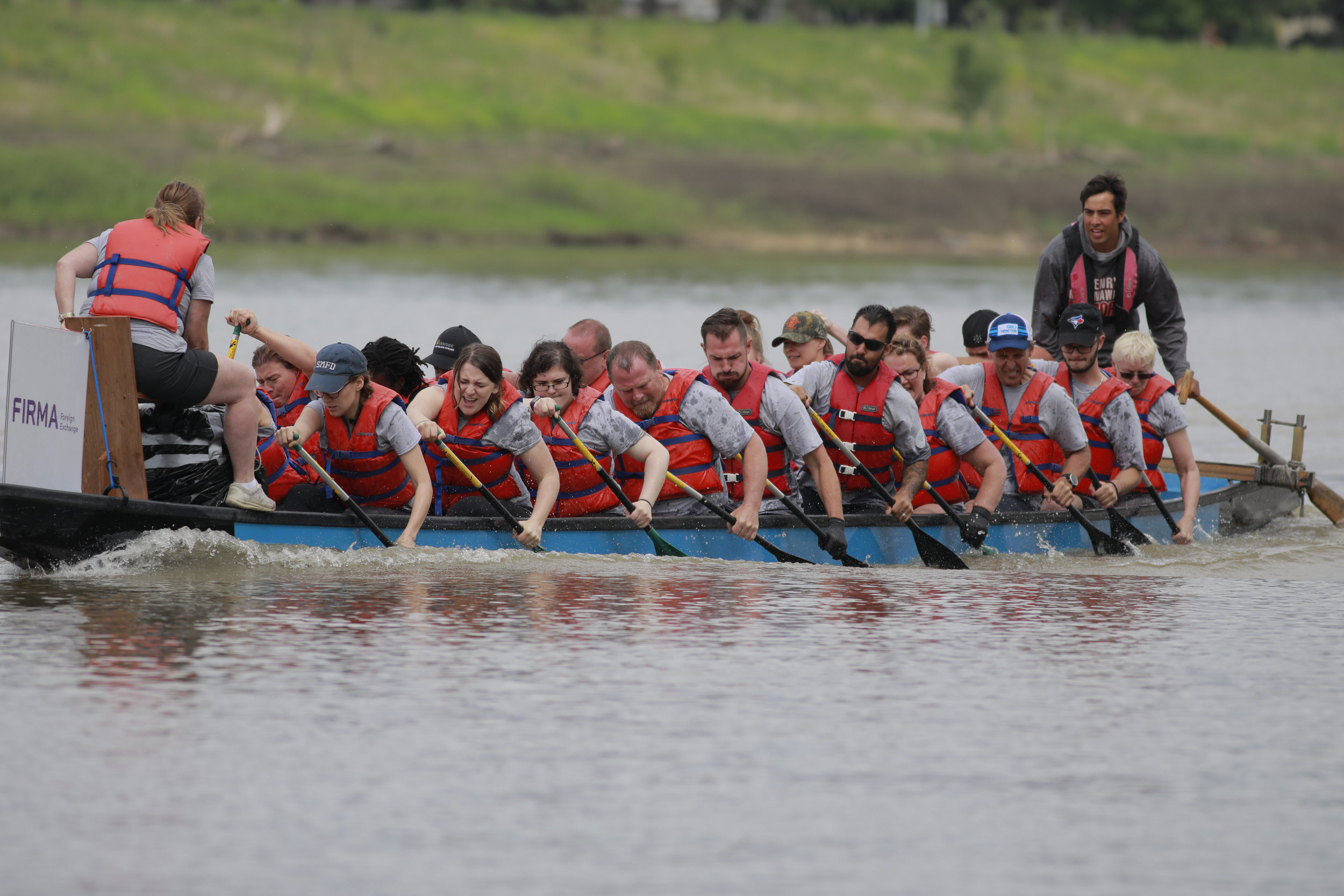 Pictured:   Karmyn's Sushi Krew  paddling hard as the  Top Fundraising Team  of the 2019 River City Dragon Boat Festival