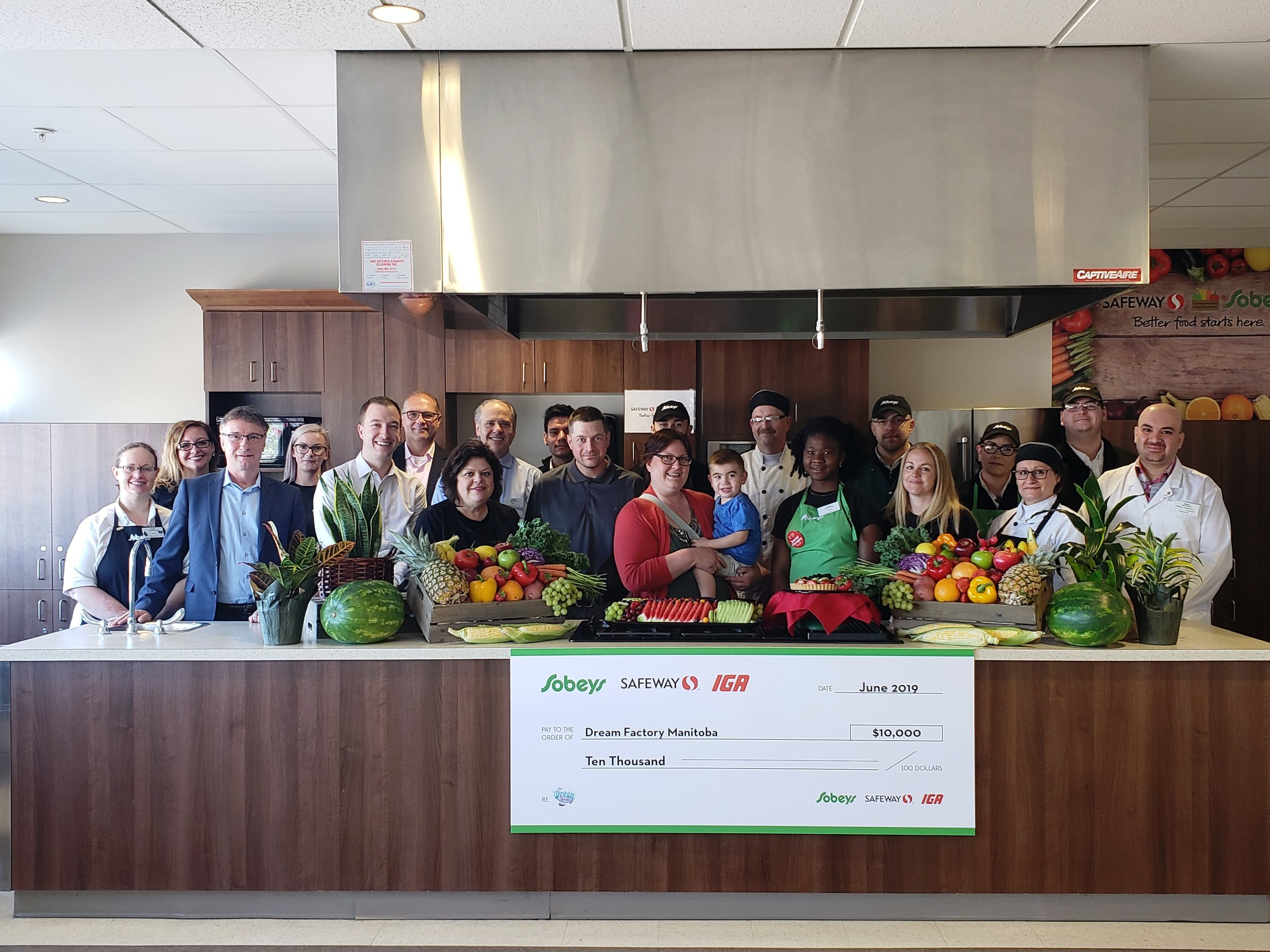 Pictured:  The team at Sobeys Extra (2850 Pembina) celebrates this exciting new partnership with The Dream Factory staff and Dream Kid Karsen and his family.