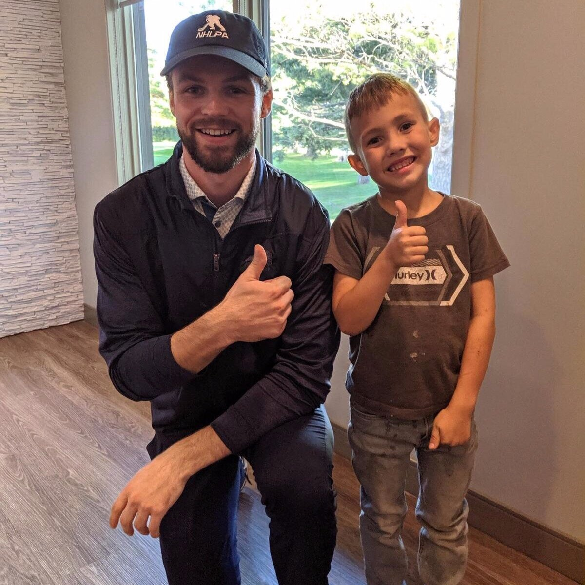 Pictured:  Dream Factory Ambassador Josh Morrissey with Dream Kid Jaxx at the Exchange Income Corporation Golf Fundraiser - over $130,000 raised to make dreams come true!