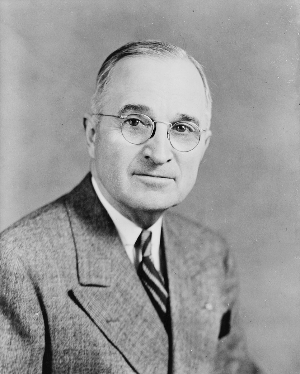 964px-Harry_S_Truman,_bw_half-length_photo_portrait,_facing_front,_1945.jpg