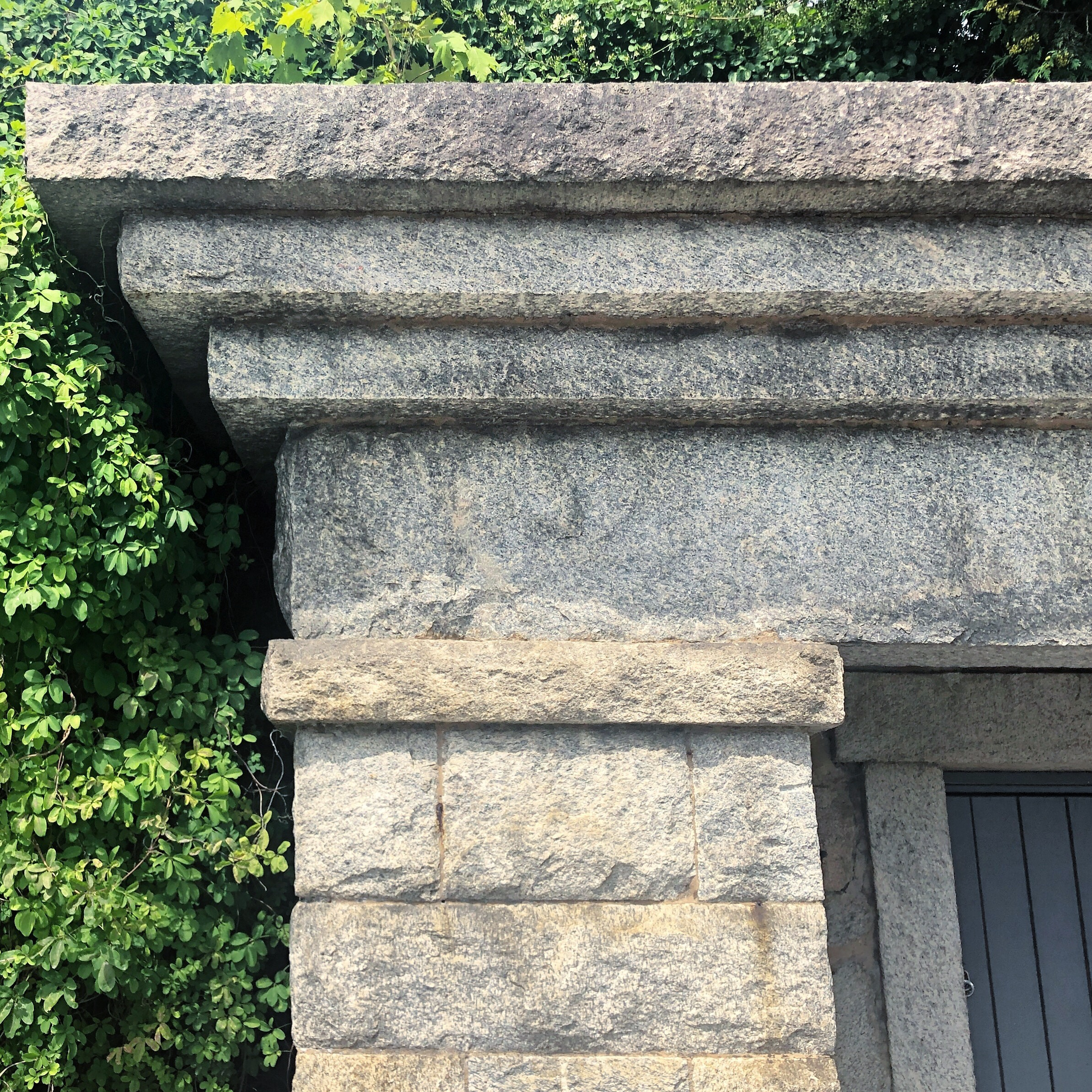 Granite piers and lintels are massive, but proportional to one another