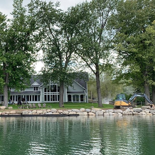 Things are coming along on this beautiful lakefront home: boulders are being placed; the dock installation has begun, and the bluestone porch is looking sharp!