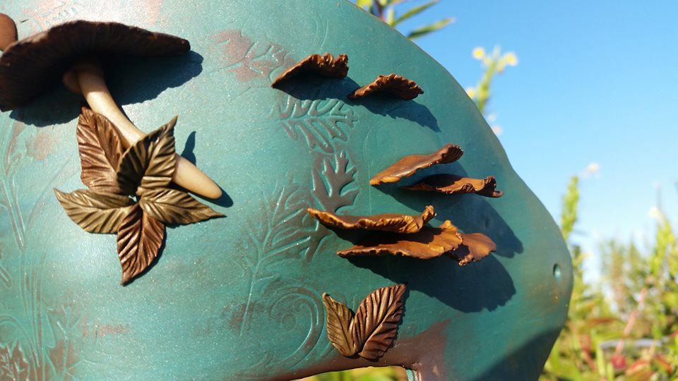 A hint of fall - Leaves and three types of mushrooms on an embossed blue mask